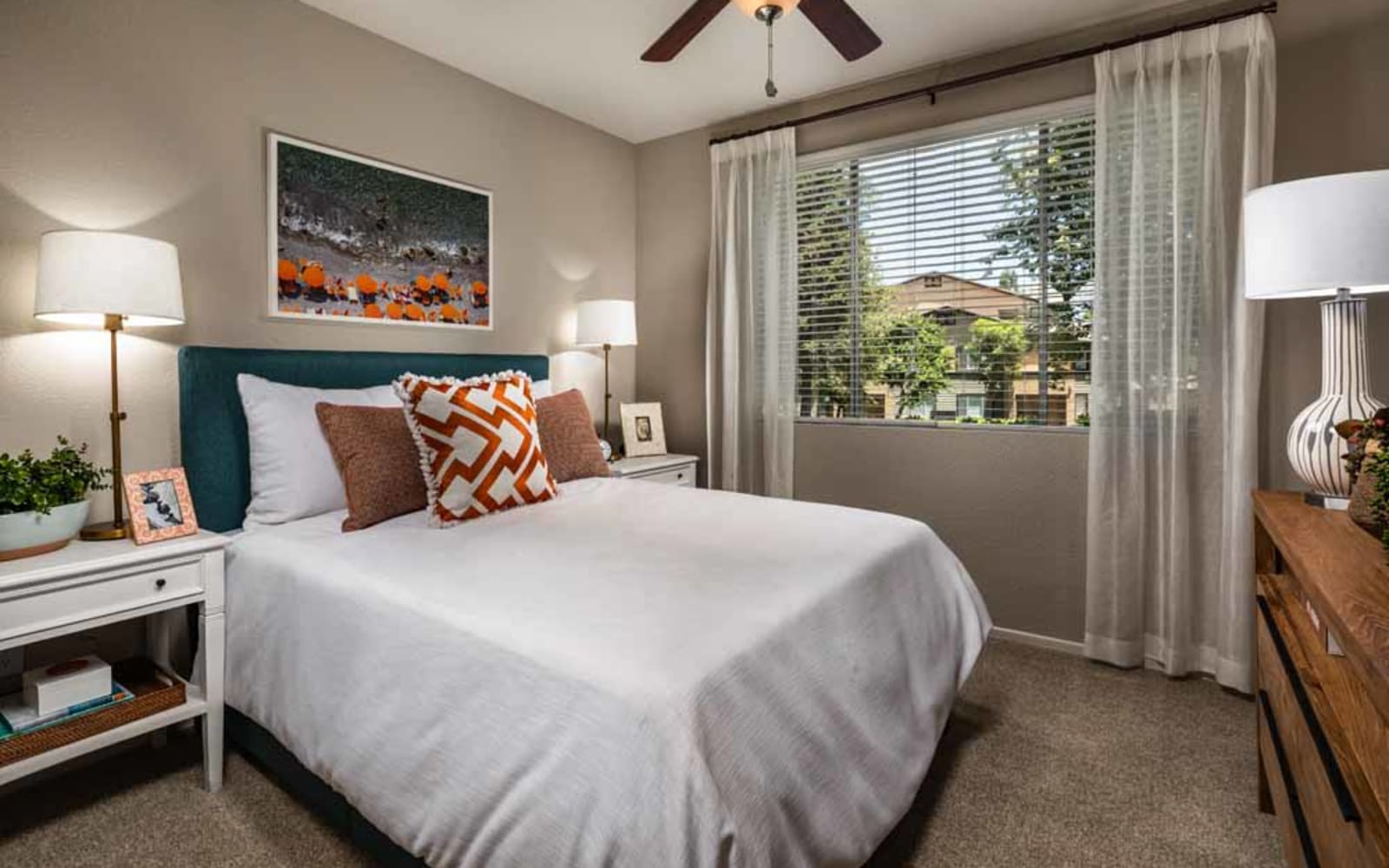 A carpeted apartment bedroom at Colonnade at Sycamore Highlands in Riverside, California