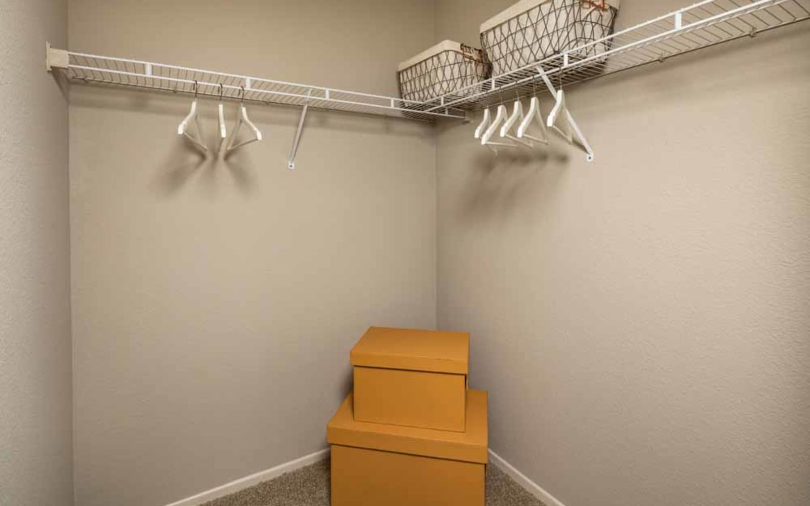 A walk-in closet at Colonnade at Sycamore Highlands in Riverside, California