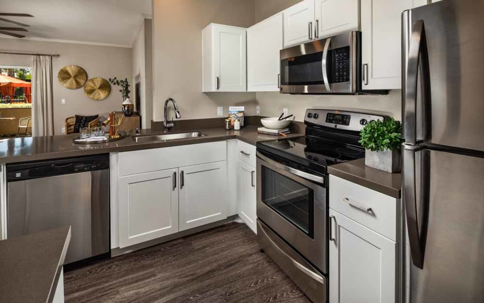 Plenty of counter space in an apartment kitchen at Colonnade at Sycamore Highlands in Riverside, California