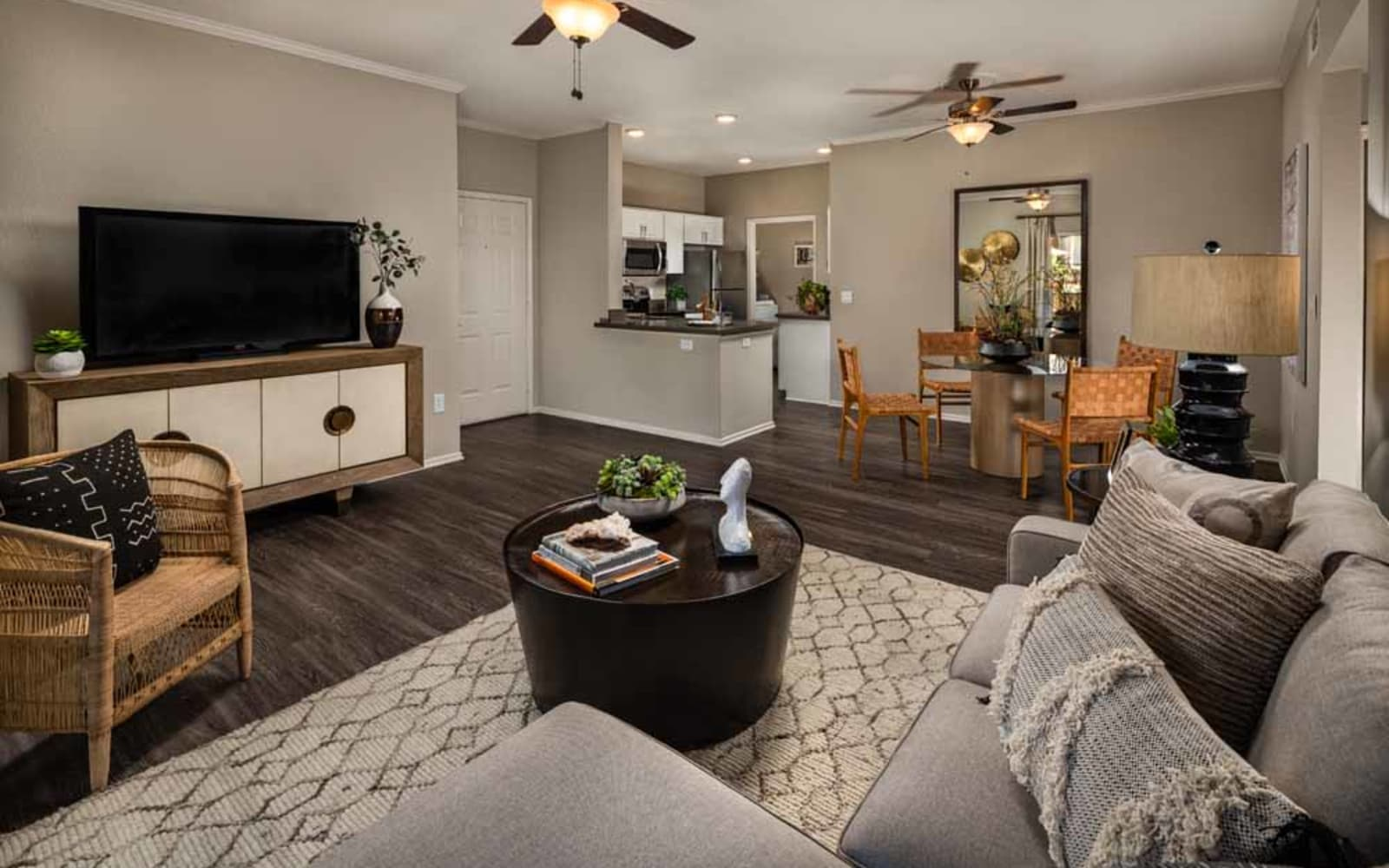 A furnished apartment living room at Colonnade at Sycamore Highlands in Riverside, California