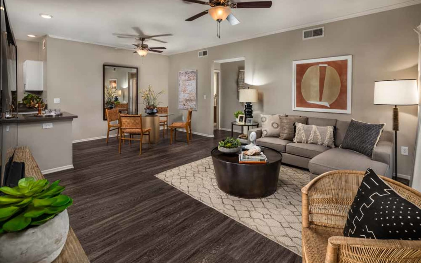 A decorated apartment living room and dining room at Colonnade at Sycamore Highlands in Riverside, California