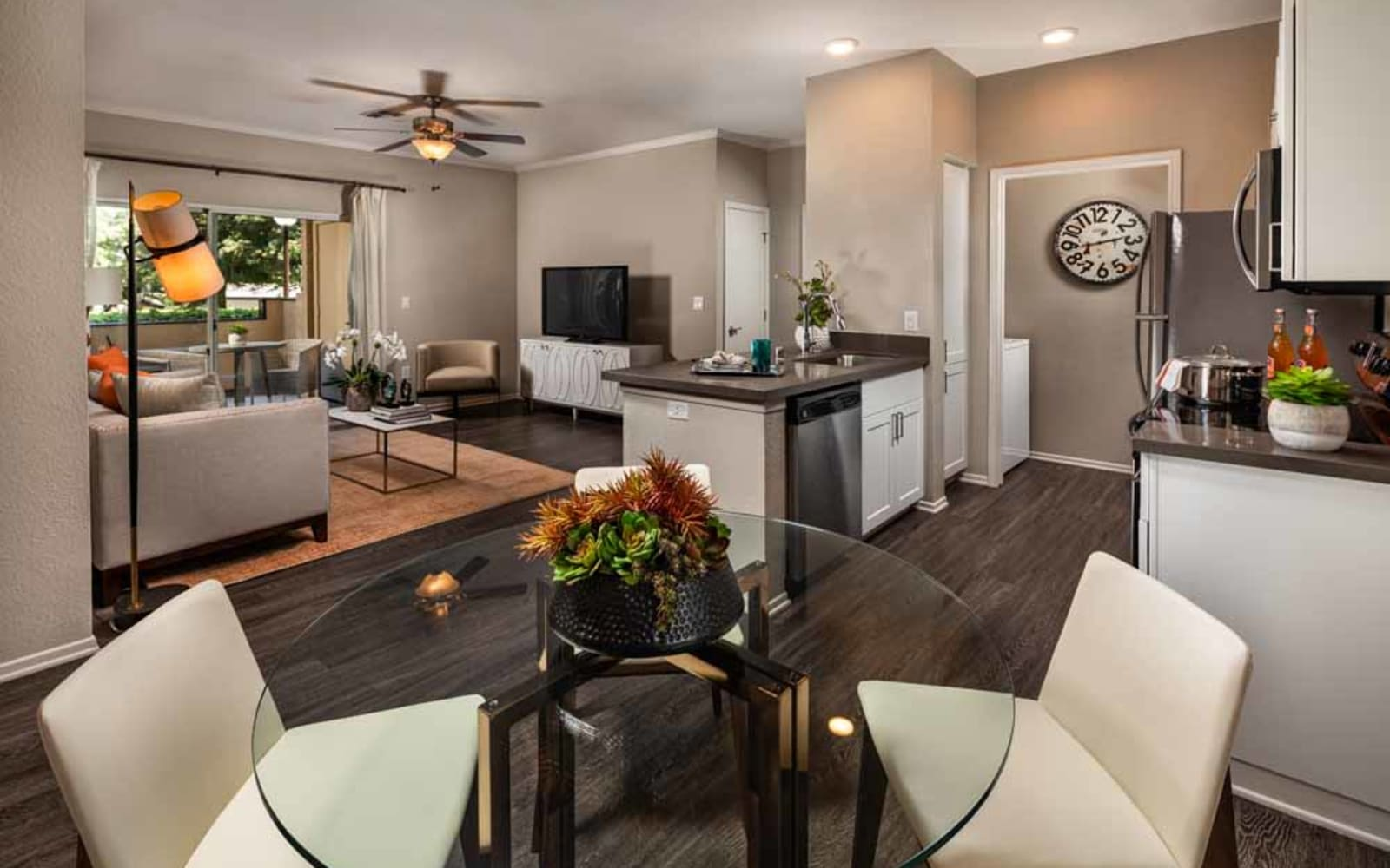 An inviting apartment kitchen, dining room and living room at Colonnade at Sycamore Highlands in Riverside, California