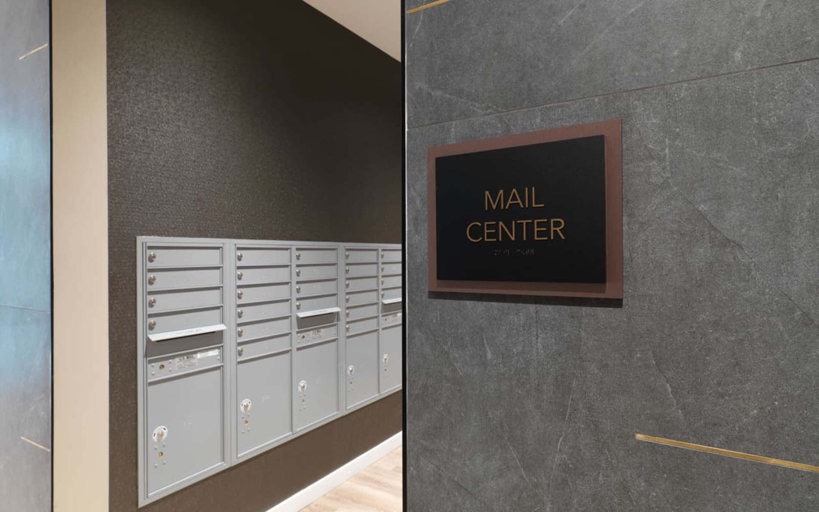Mail center at North Square Apartments at The Mill District in Amherst, Massachusetts