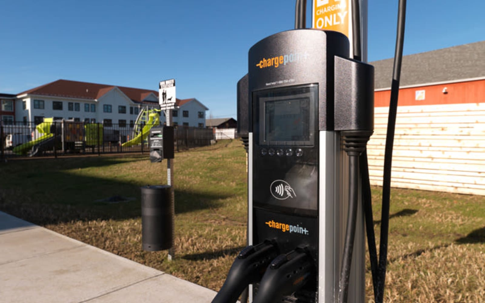 Electric car charging at North Square Apartments at The Mill District in Amherst, Massachusetts