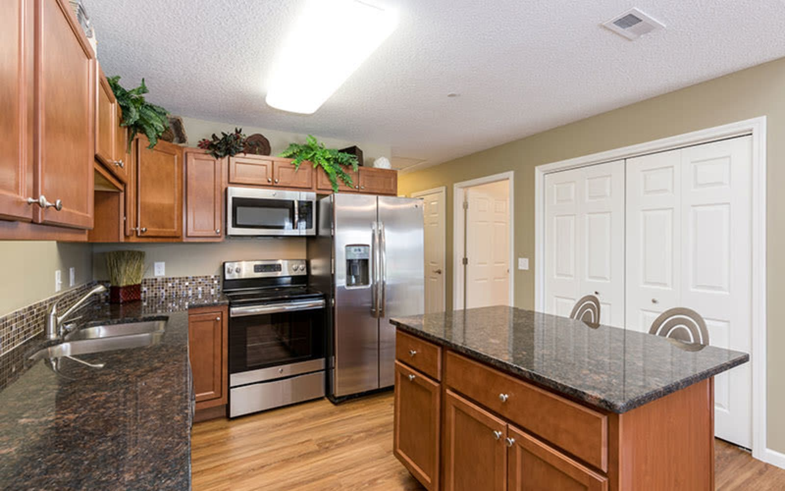 Upgraded appliances in an apartment kitchen at The Landing of Clinton in Clinton, Iowa