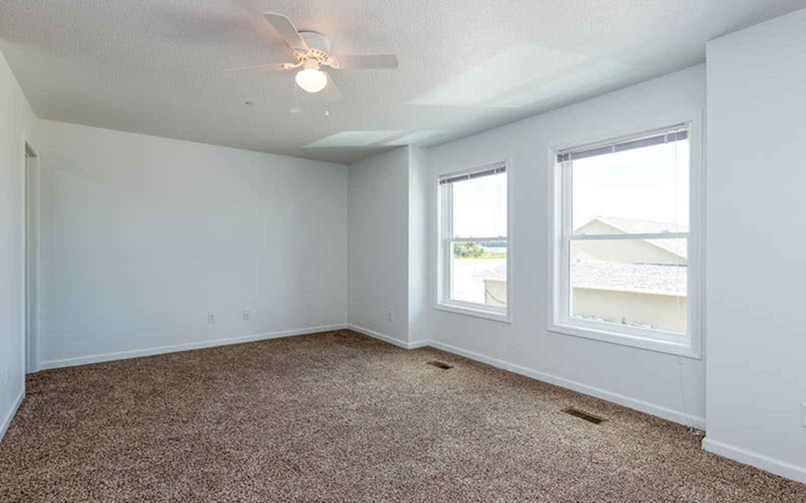 A spacious empty bedroom at The Landing of Clinton in Clinton, Iowa