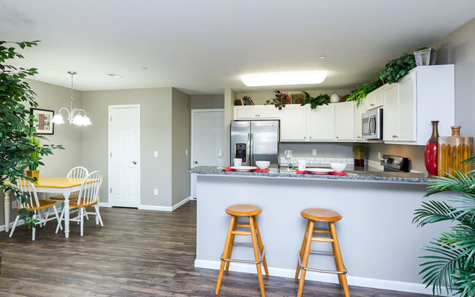 An apartment kitchen and dining room at The Landing of Clinton in Clinton, Iowa