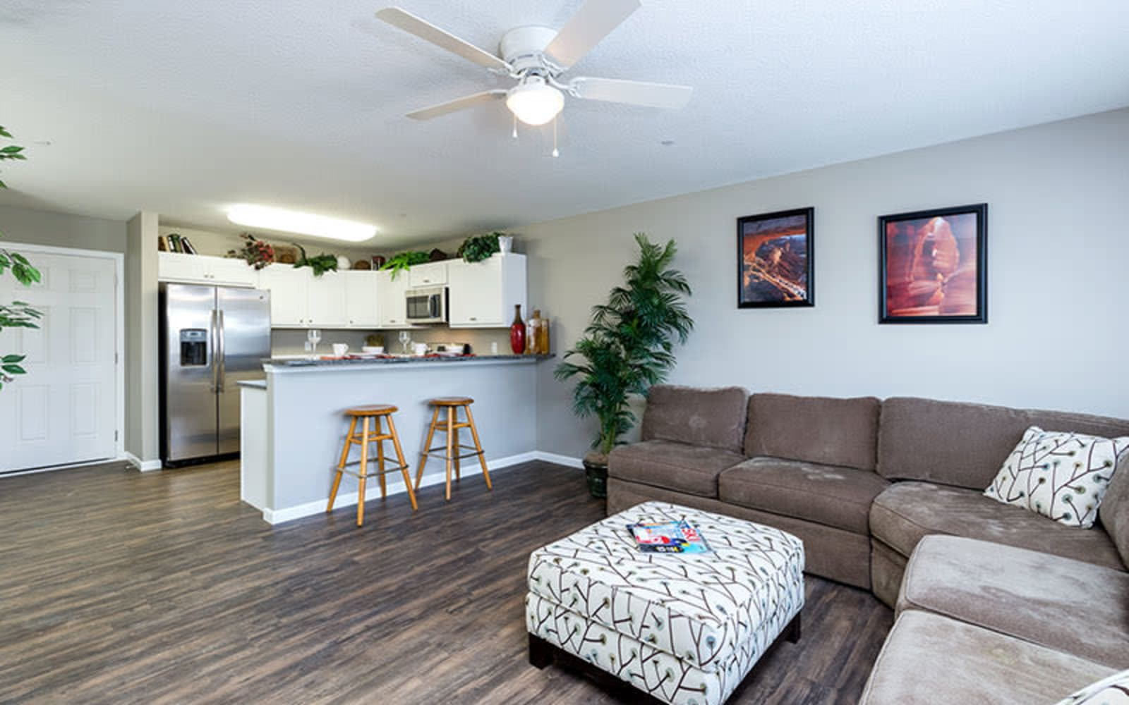 Wood flooring in an apartment kitchen and living room at The Landing of Clinton in Clinton, Iowa