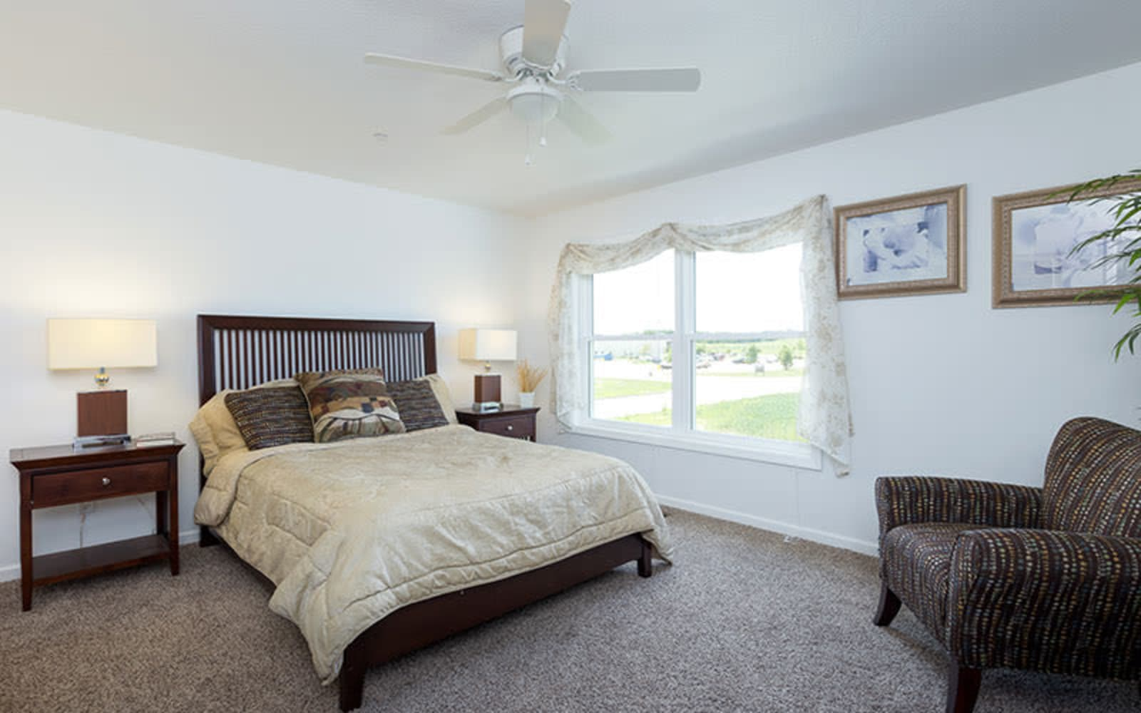 An inviting master bedroom at The Landing of Clinton in Clinton, Iowa