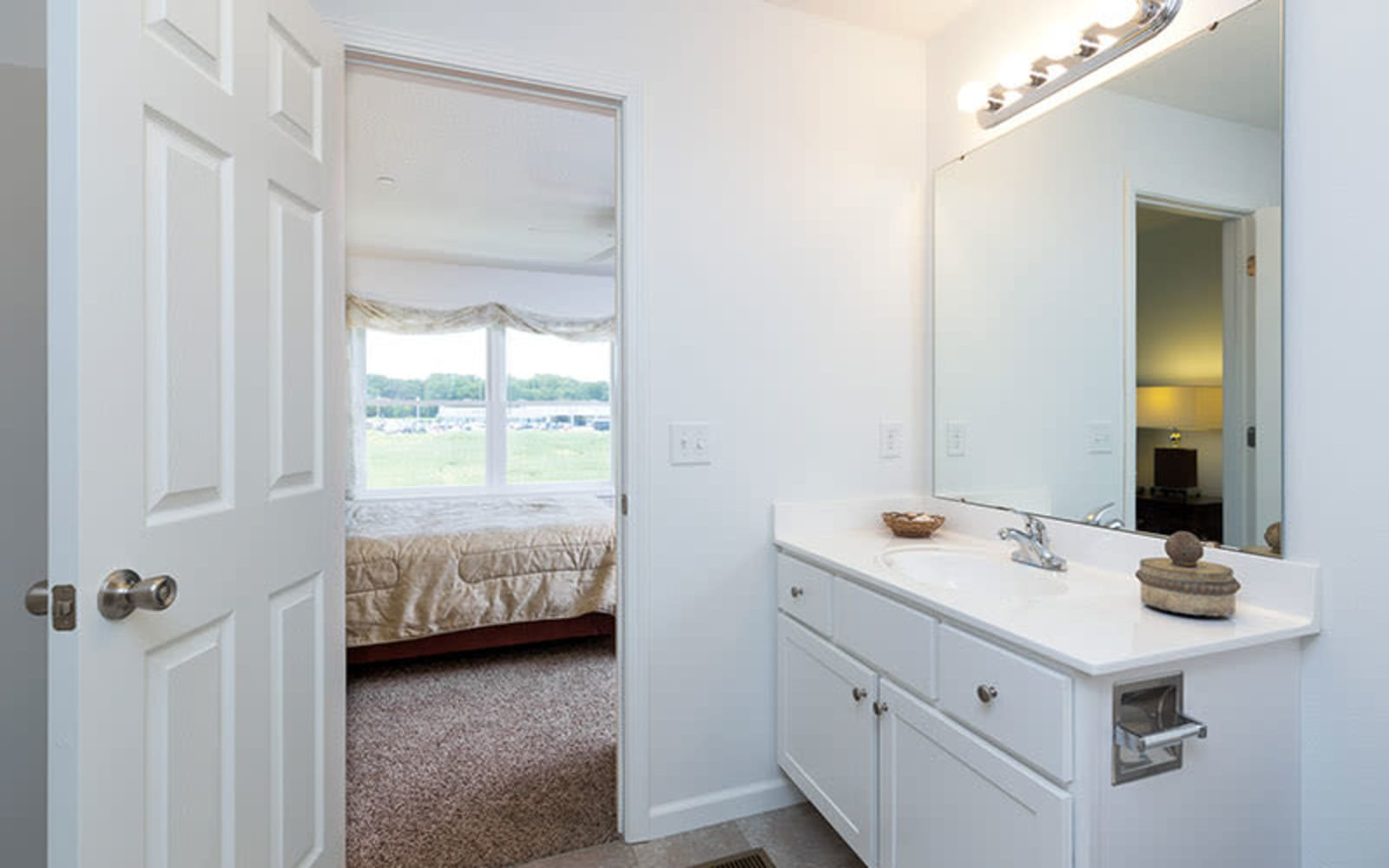 An attached master bathroom at The Landing of Clinton in Clinton, Iowa