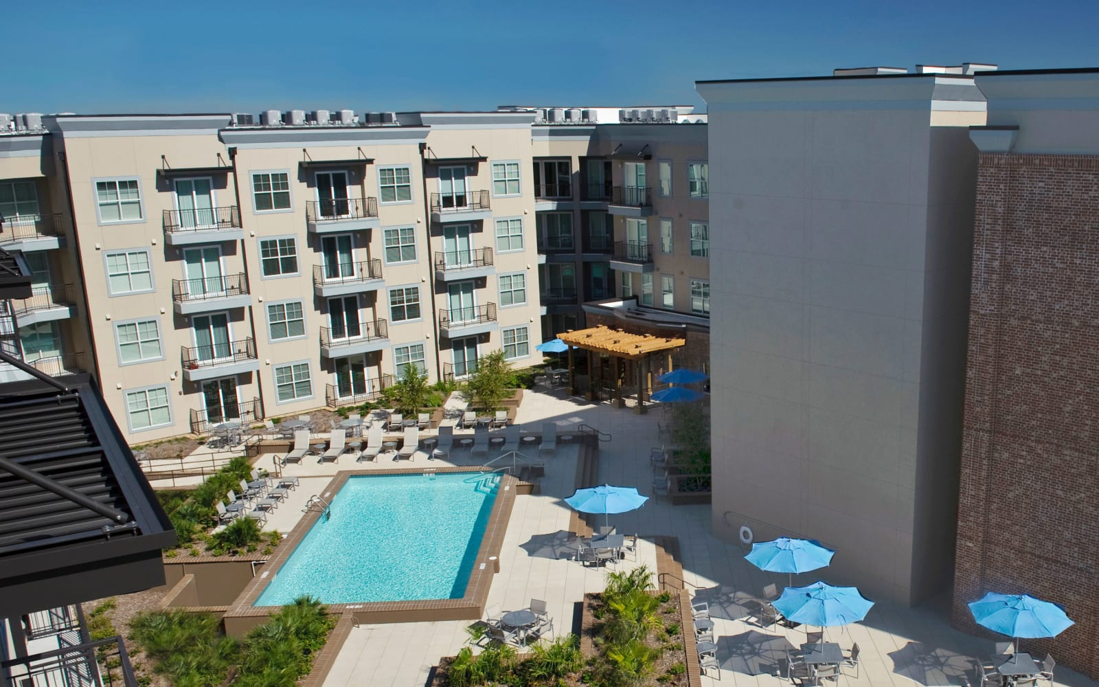 Outdoor pool on a bright day at Crescent Club in New Orleans, Louisiana