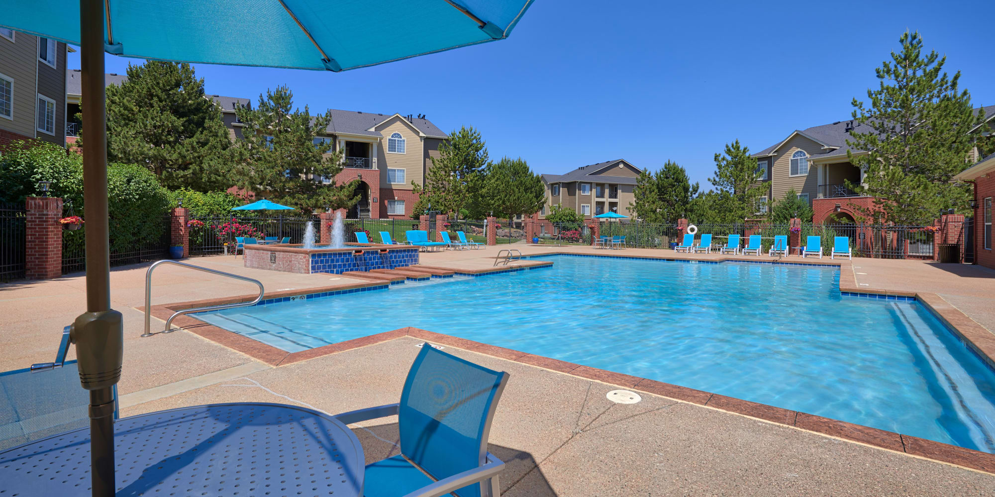 Pool view with lounges and umbrellas in Lakewood, CO