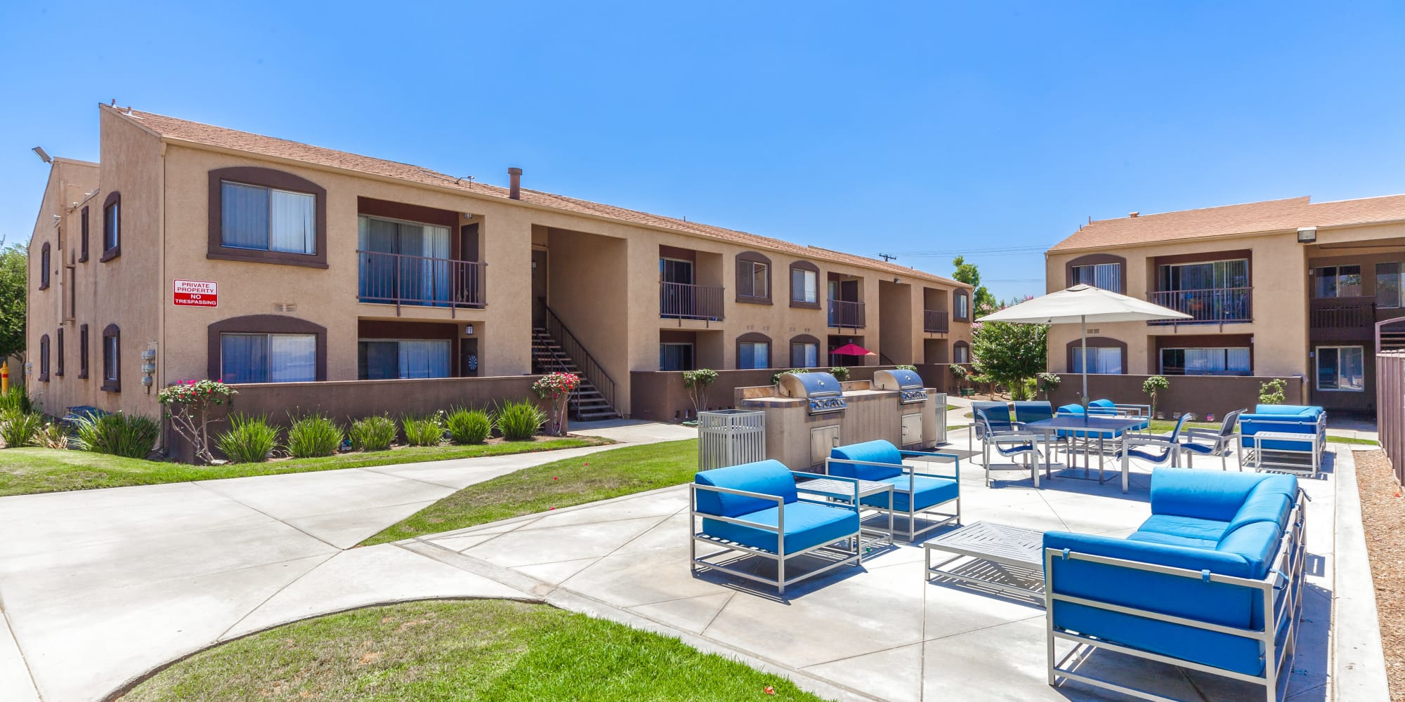 Courtyard with outdoor seating at West Fifth Apartments in Ontario, California