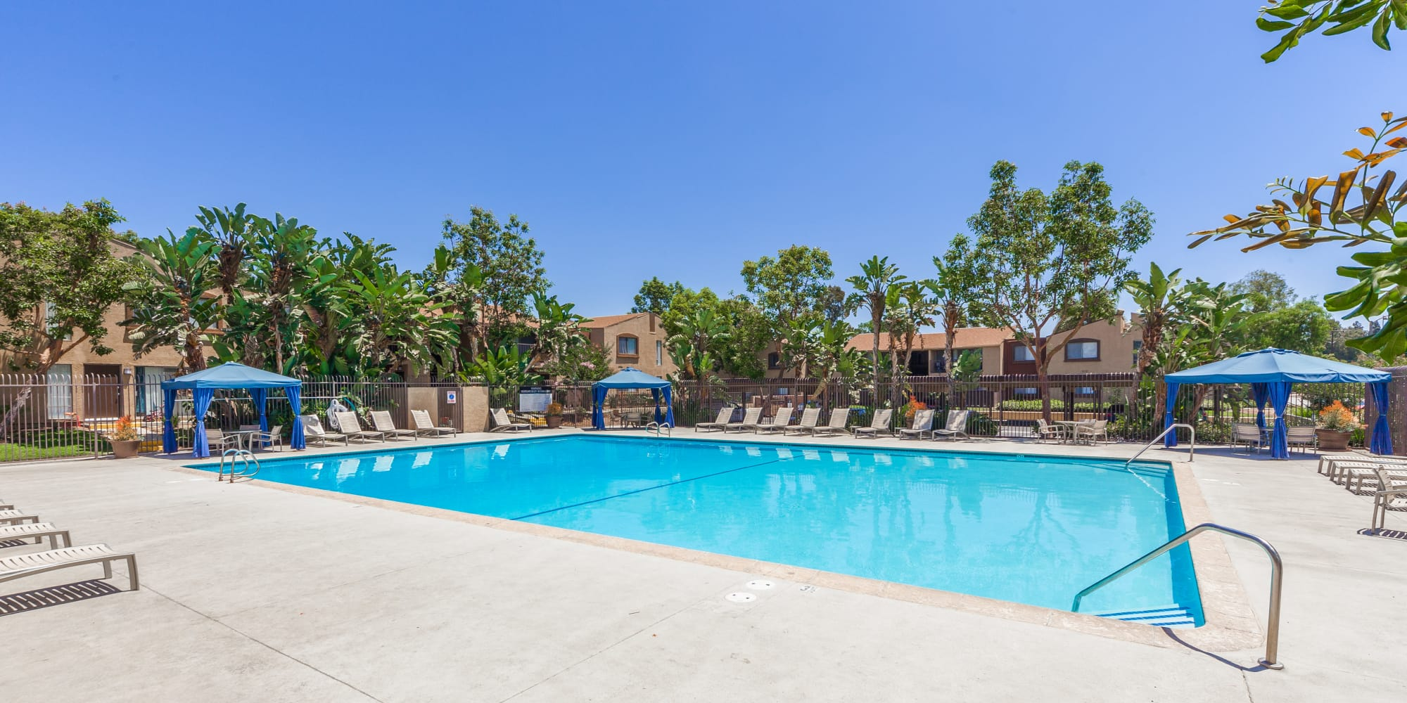Swimming pool with spacious sundeck at West Fifth Apartments in Ontario, California