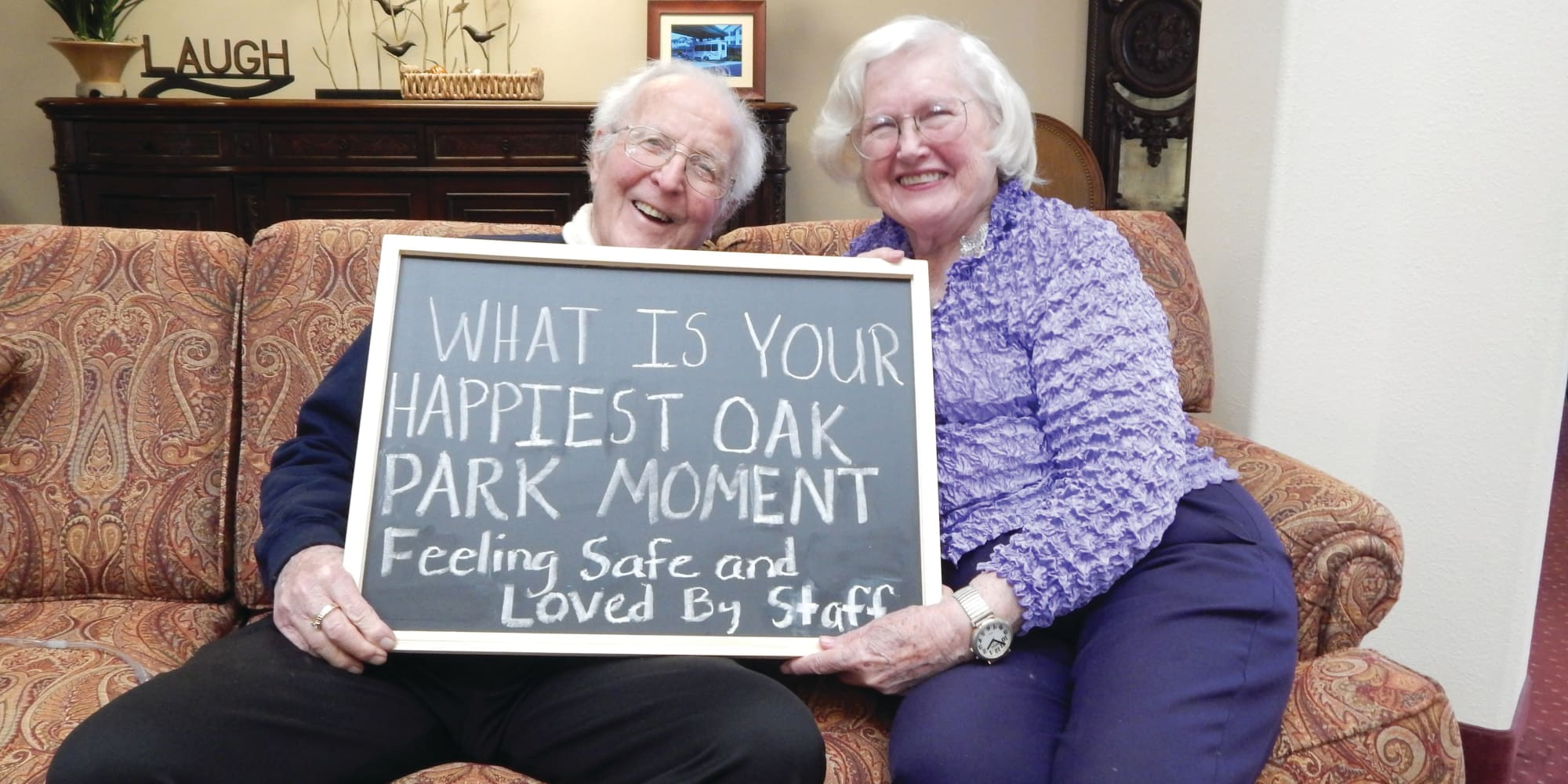 Residents holding a sign about their happiest moment at Oak Park Retirement in Salisbury, North Carolina