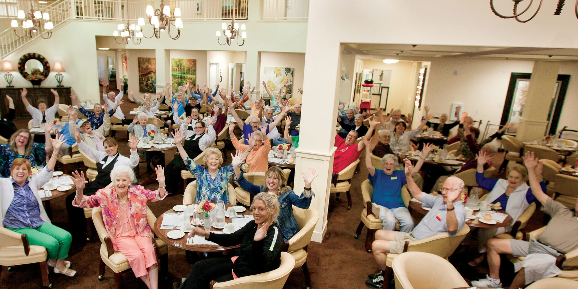 Residents and staff in the dining room at Pioneer Ridge Gracious Retirement Living in McKinney, Texas