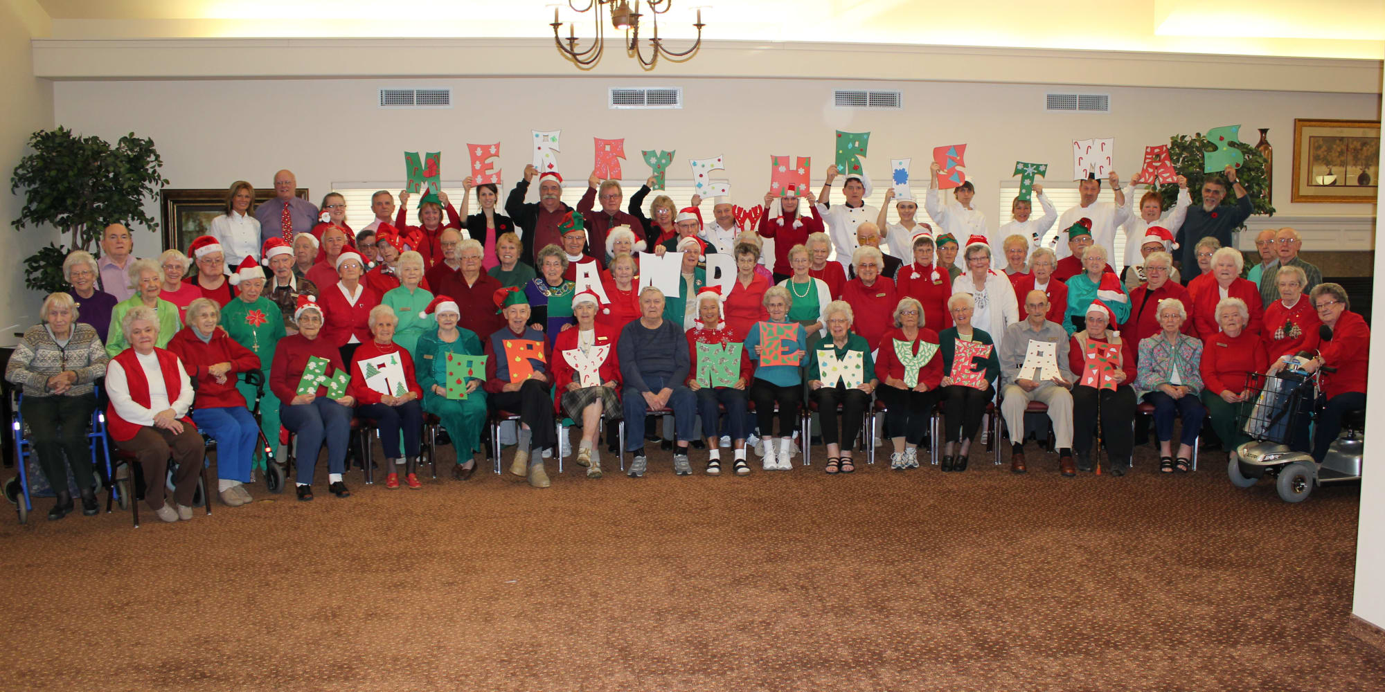 A group photo of residents at Rosewood Estates in Cobourg, Ontario