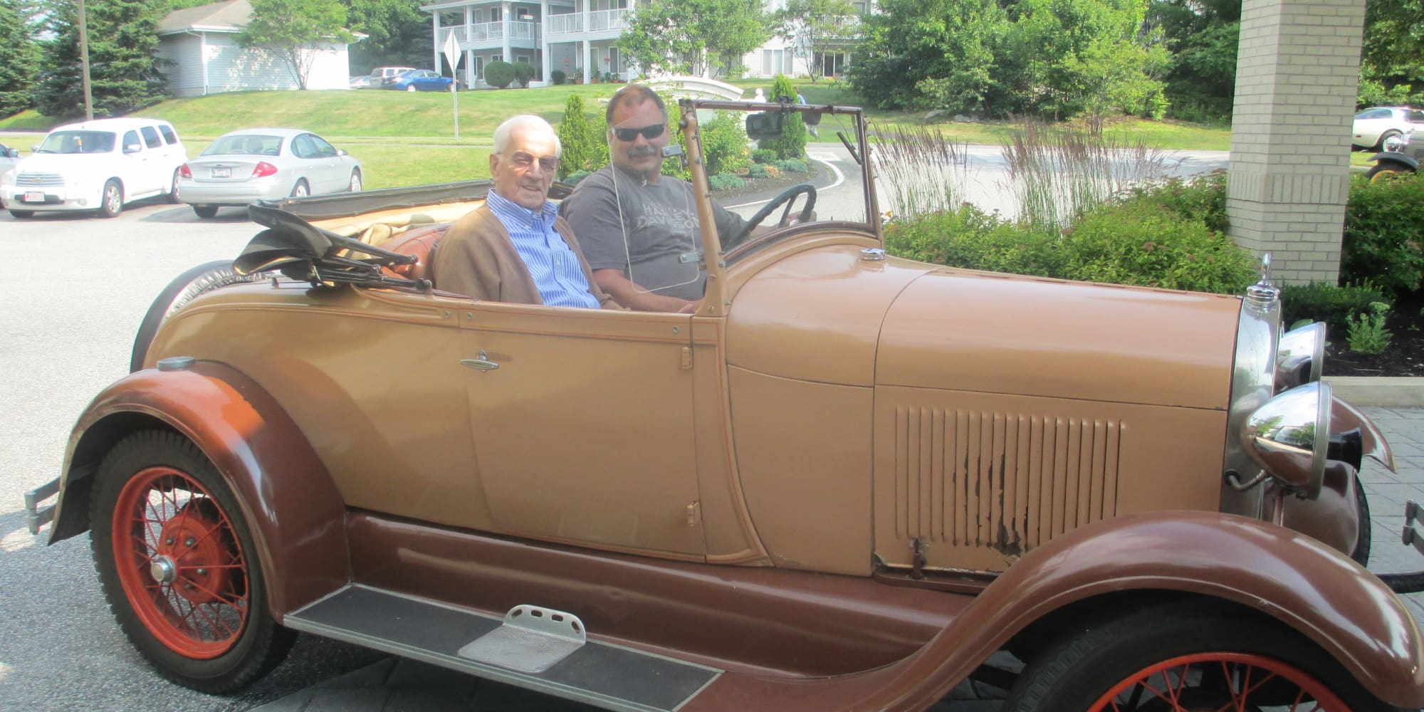 Residents in a classic car at Salishan Gracious Retirement Living in Spring Hill, Florida