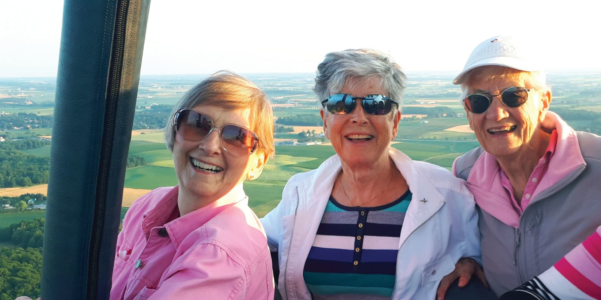 Three residents from Somerset Lodge in Gladstone, Oregon in a hot air balloon