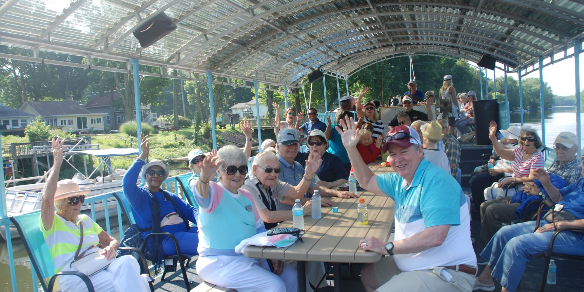 A large group of residents from Southern Pines Gracious Retirement Living in Southern Pines, North Carolina on a boat