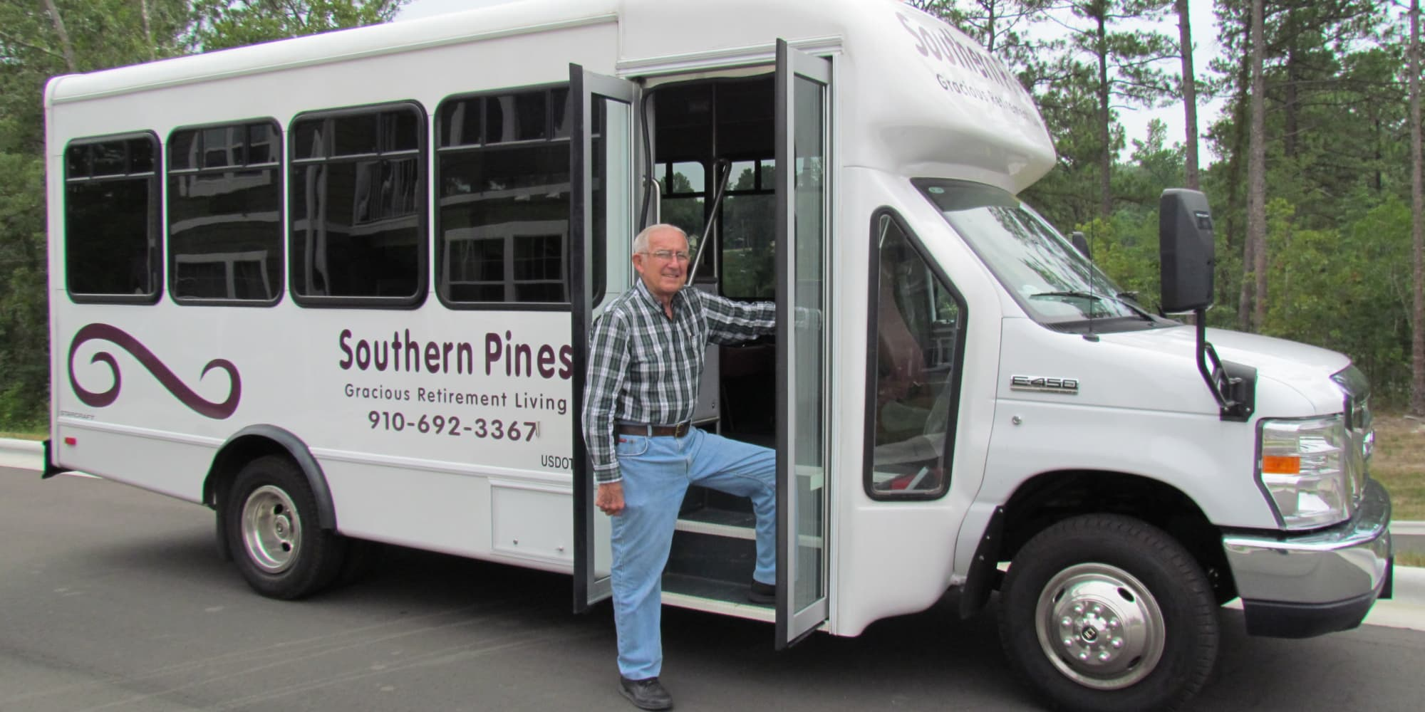 A resident stepping into the community bus at Southern Pines Gracious Retirement Living in Southern Pines, North Carolina