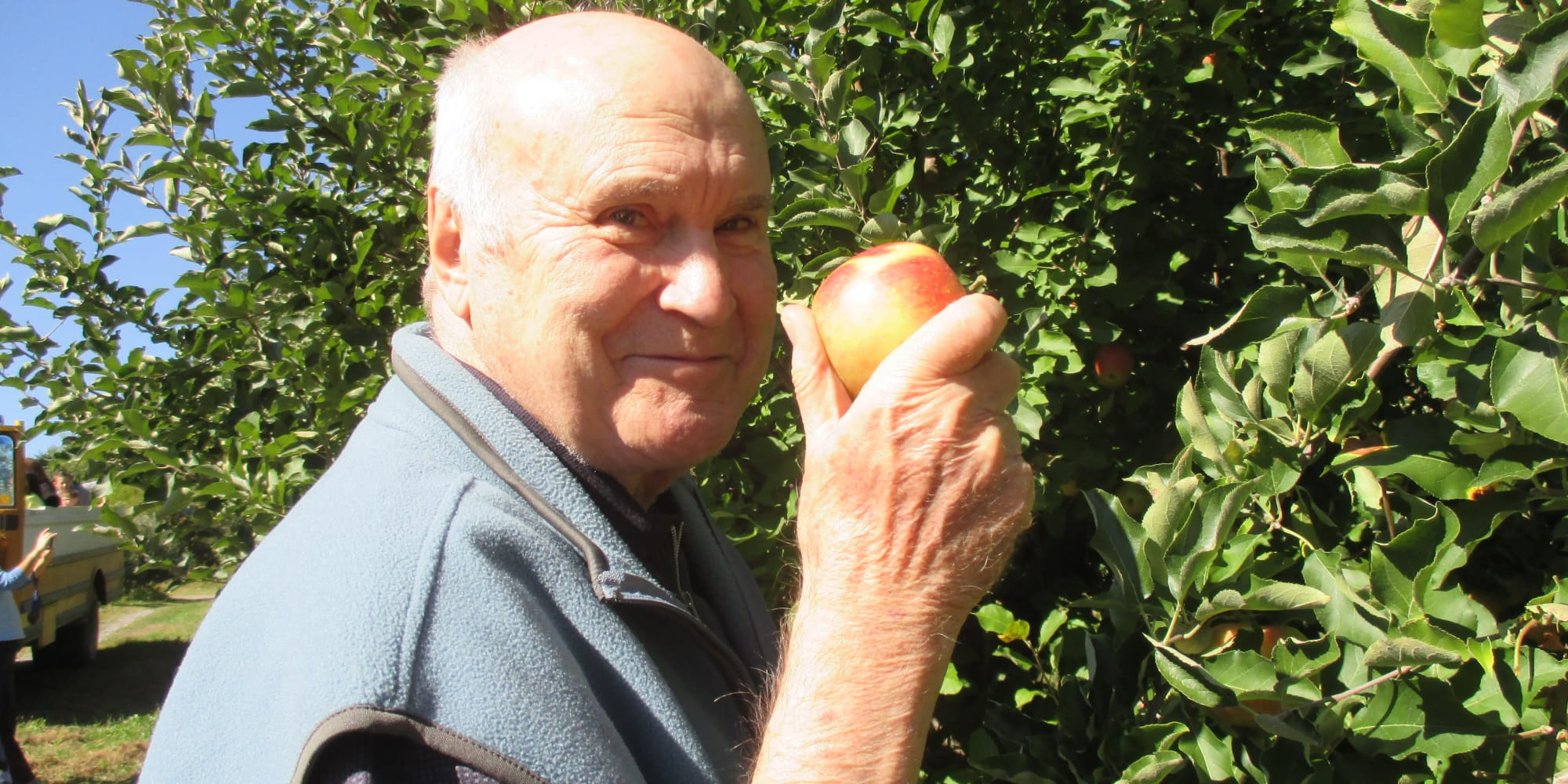 A resident from Sterling Heights Gracious Retirement Living in Bethlehem, Pennsylvania picking apples