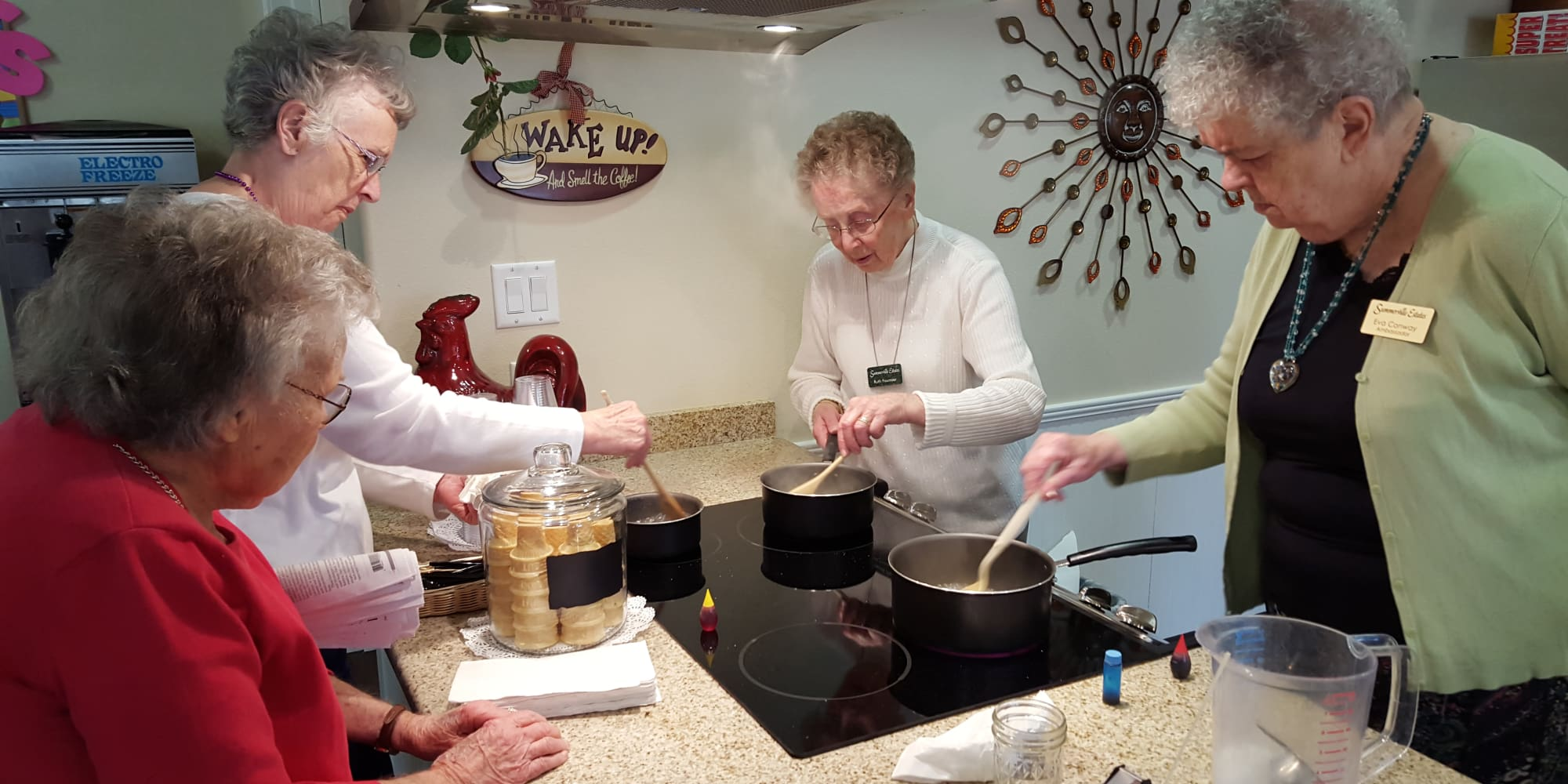 Residents cooking together at Summerville Estates Gracious Retirement Living in Summerville, South Carolina