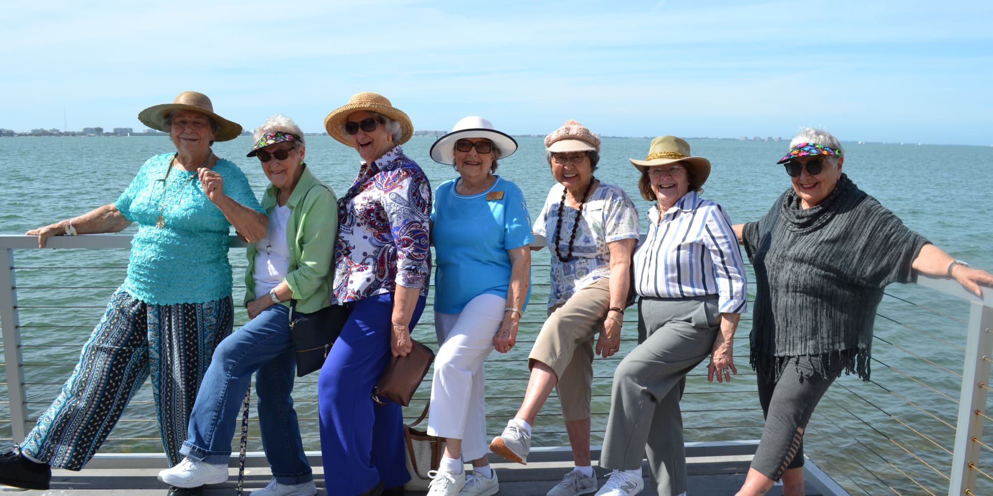 Residents from The Palms at LaQuinta Gracious Retirement Living in La Quinta, California posing on the waterfront