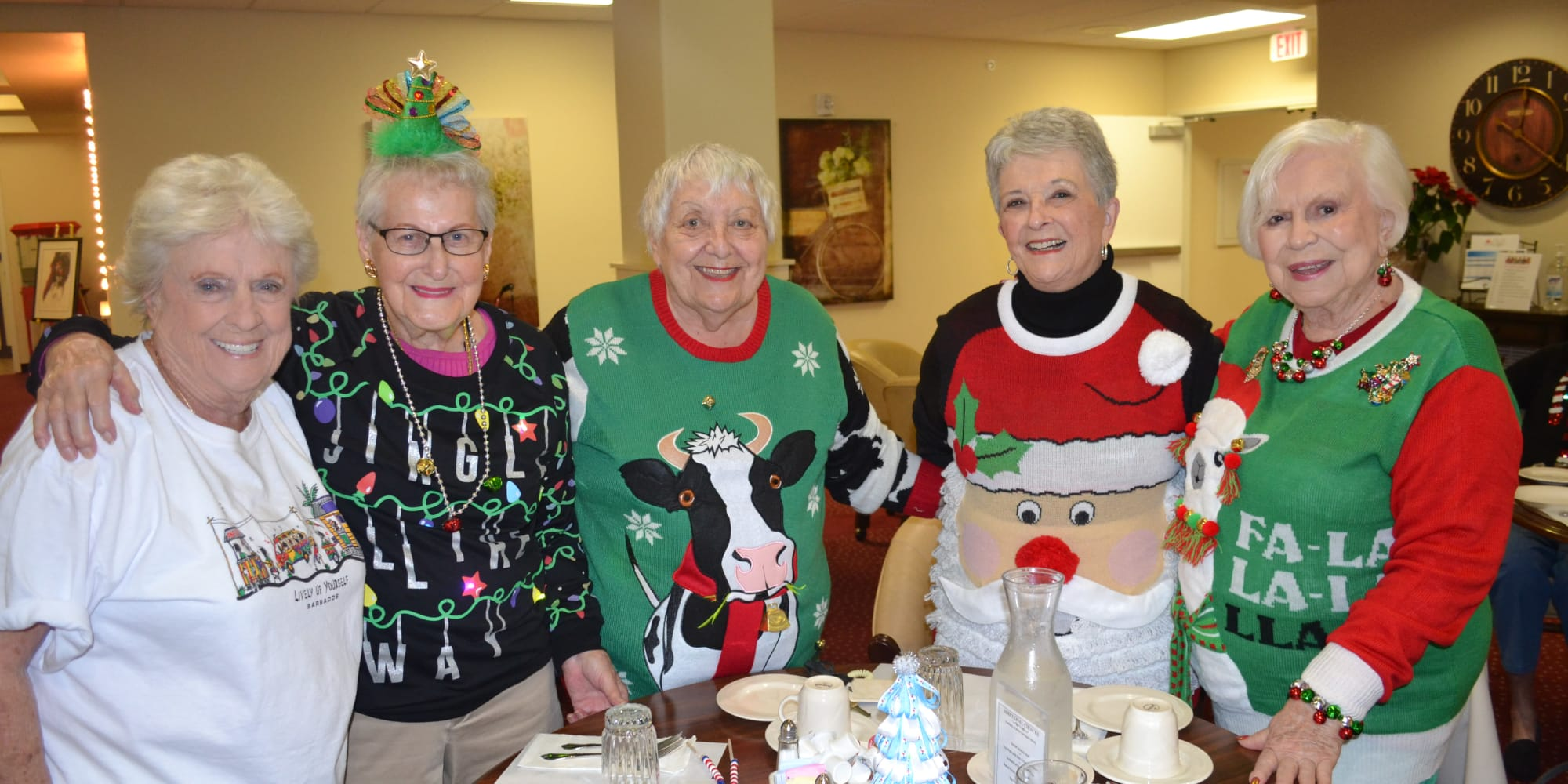 Residents in festive holiday sweaters at Mulberry Gardens Assisted Living in Munroe Falls, Ohio