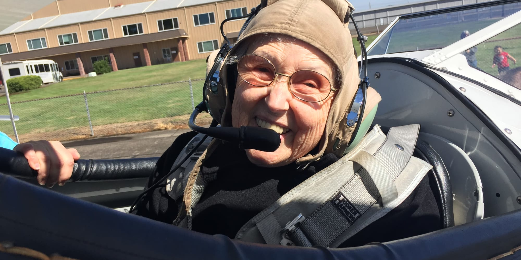 A resident front Stoneybrook Assisted Living in Corvallis, Oregon in an airplane