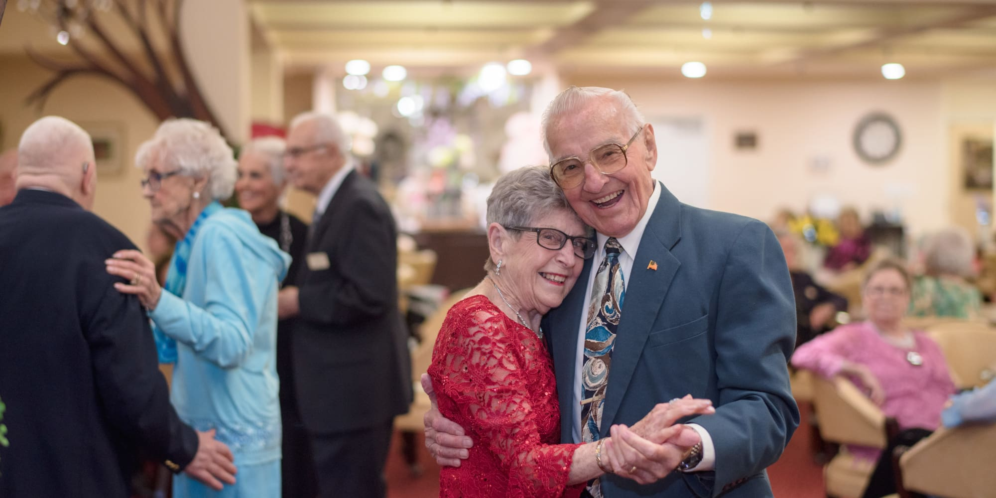 A happy couple dancing together at Camellia Gardens Gracious Retirement Living in Maynard, Massachusetts