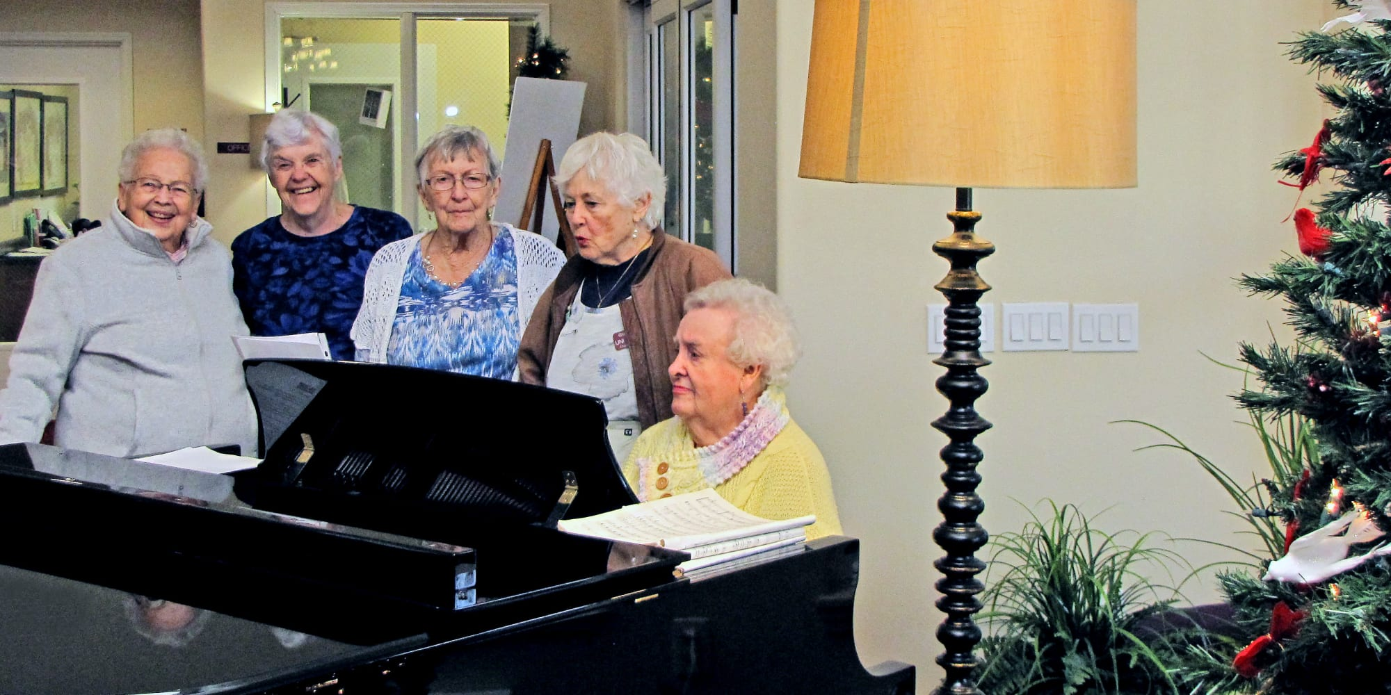 A resident playing the piano for other residents at Amber Park in Pickerington, Ohio