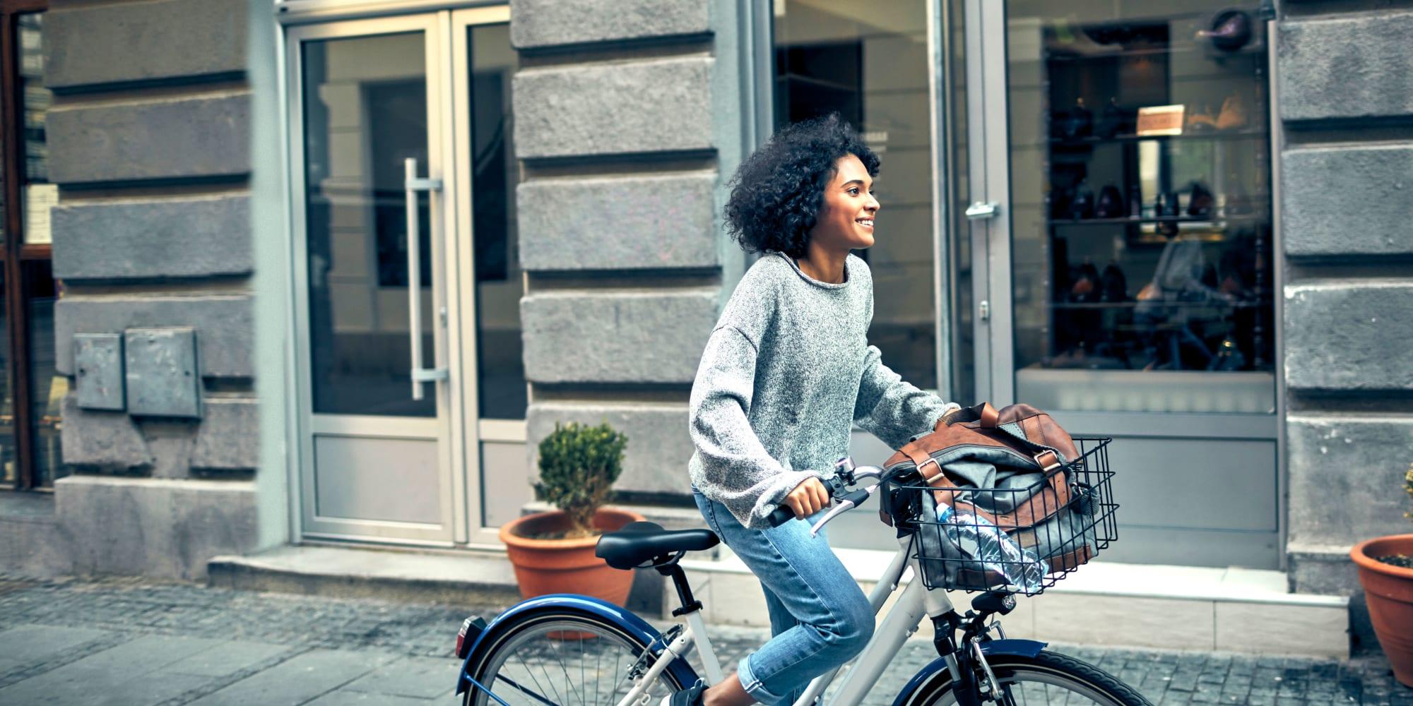 Resident enjoying a bike ride around her neighborhood near The Residences at NEWCITY in Chicago, Illinois