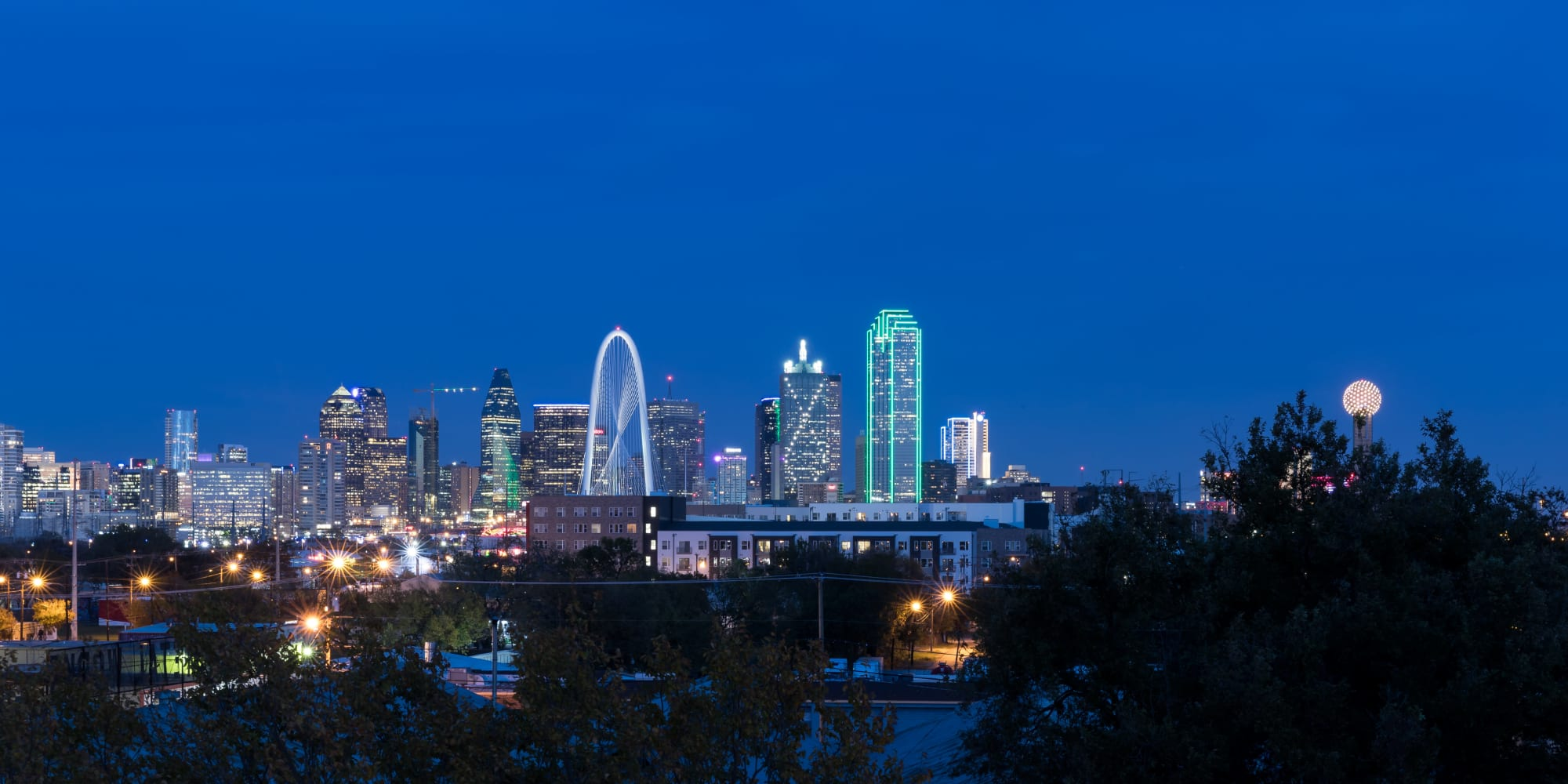 Night image of the city from apartments Alta Trinity Green in Dallas. TX