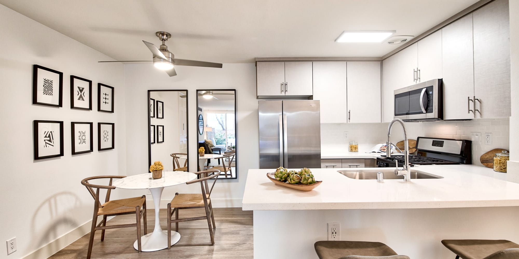 Luxury kitchen with stainless-steel appliances at The Meadows in Culver City, California