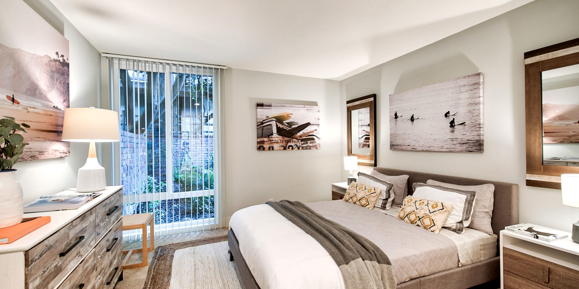 Large bedroom with wood-style flooring at The Meadows in Culver City, California