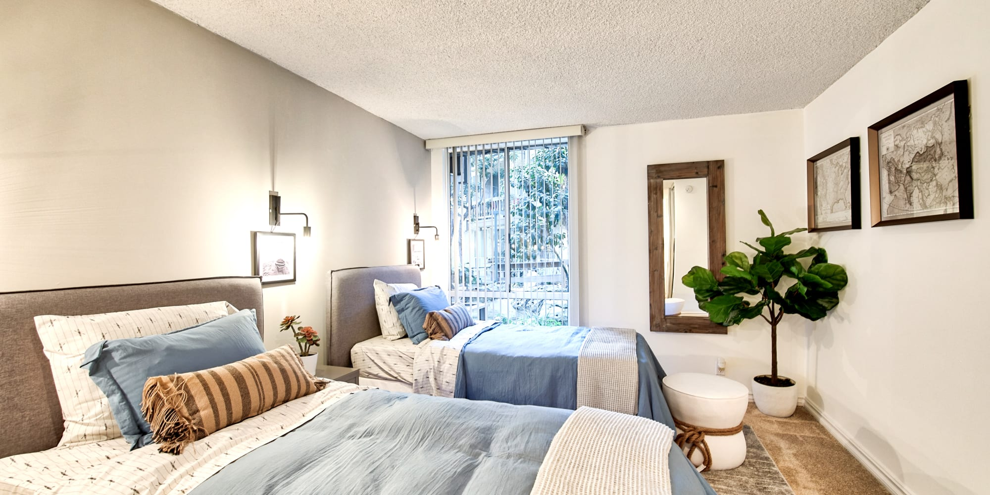 Large bedroom with enough room for two beds at The Meadows in Culver City, California