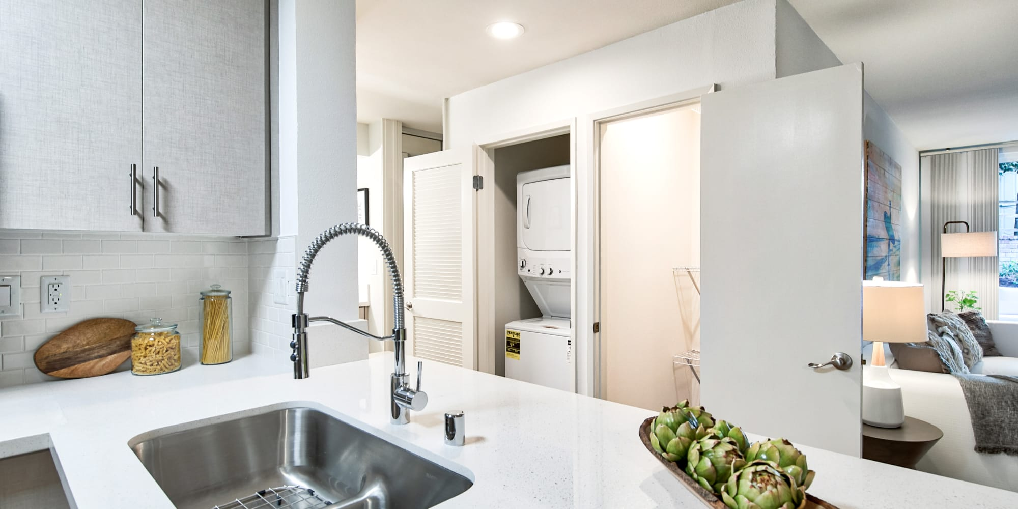 Kitchen with a large quartz countertop at The Meadows in Culver City, California