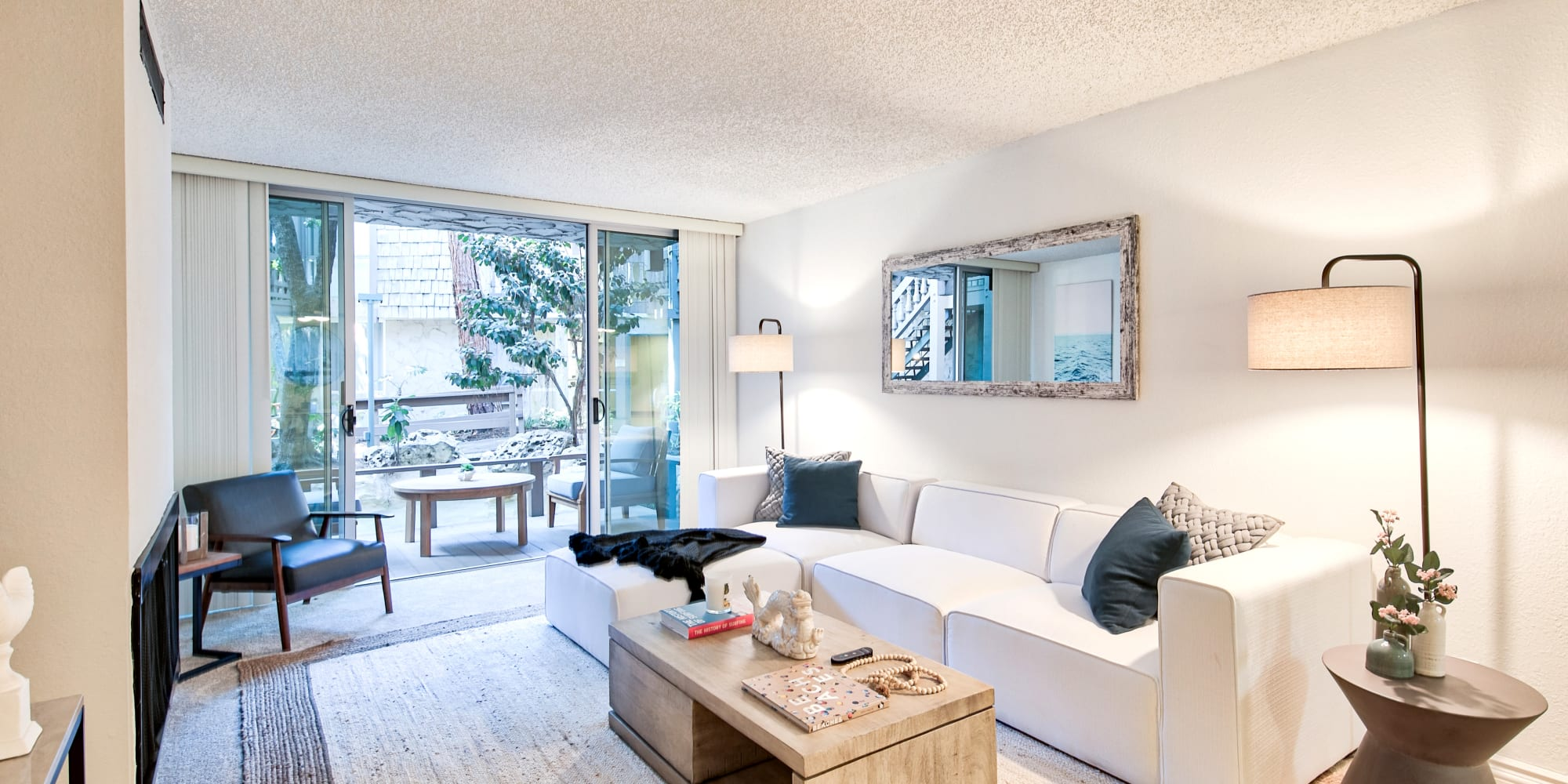 Model home's living room with private patio access at The Meadows in Culver City, California