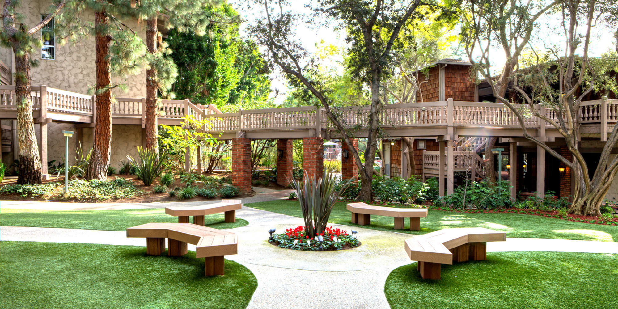 Bench seating at the center of a beautifully maintained courtyard at The Meadows in Culver City, California
