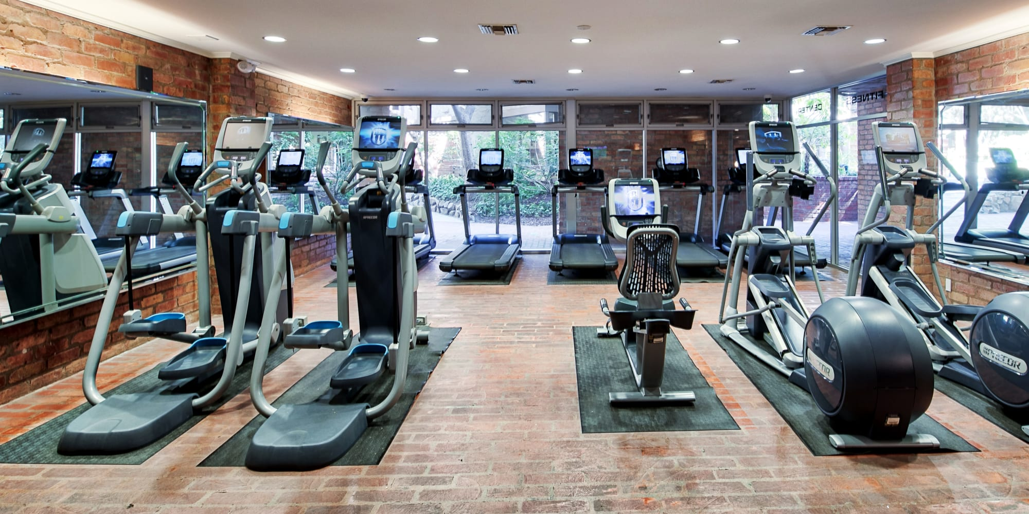 Modern fitness center with plenty of individual workout stations at The Meadows in Culver City, California