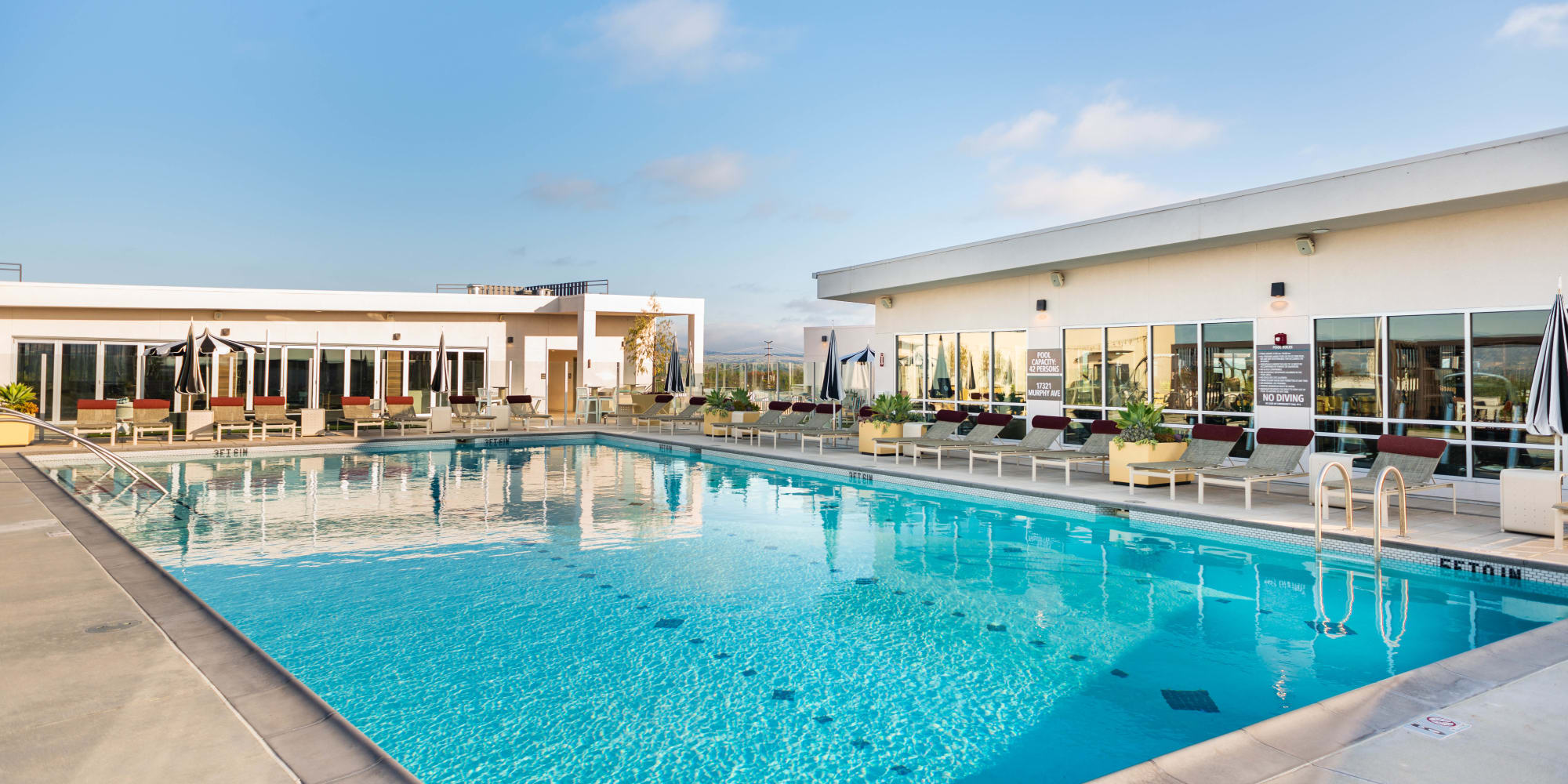 Resort-style swimming pool with underwater lap lanes at Fusion Apartments in Irvine, California