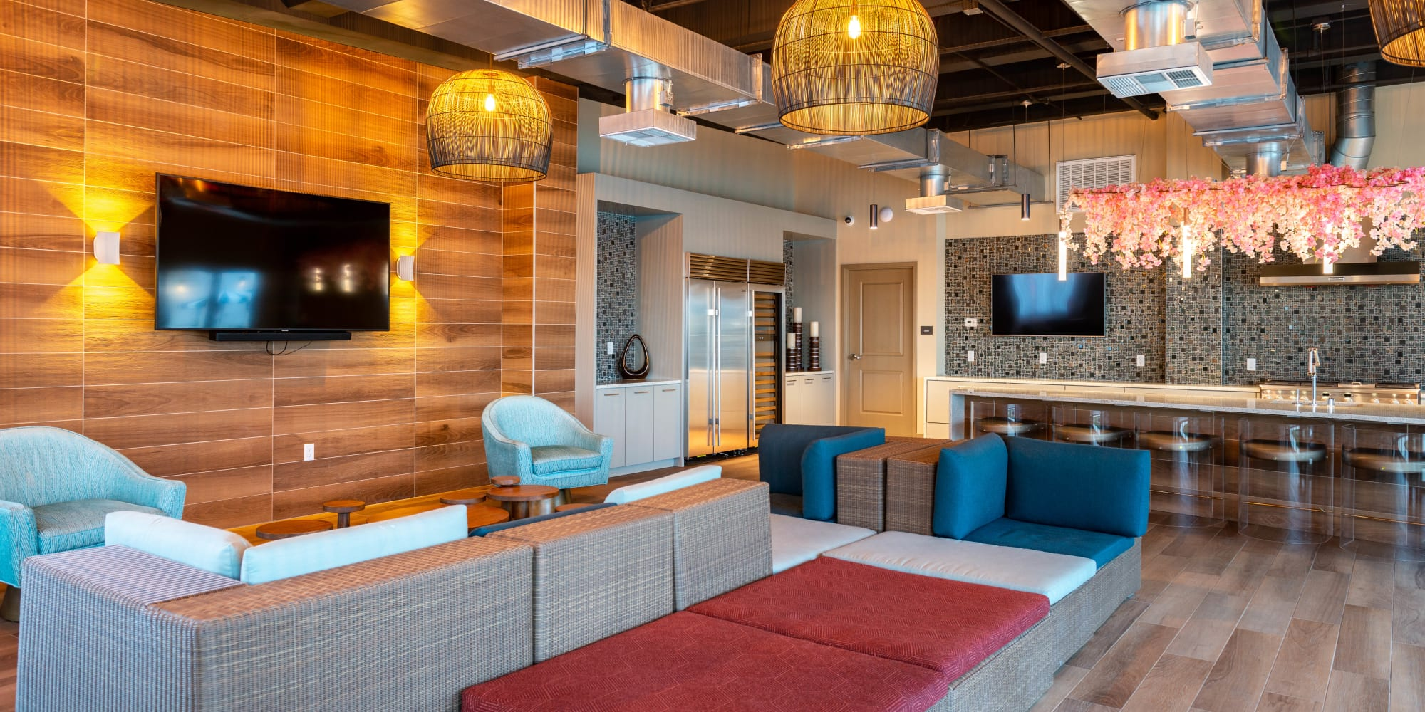 Luxurious resident clubhouse lounge with flatscreen TVs at Fusion Apartments in Irvine, California