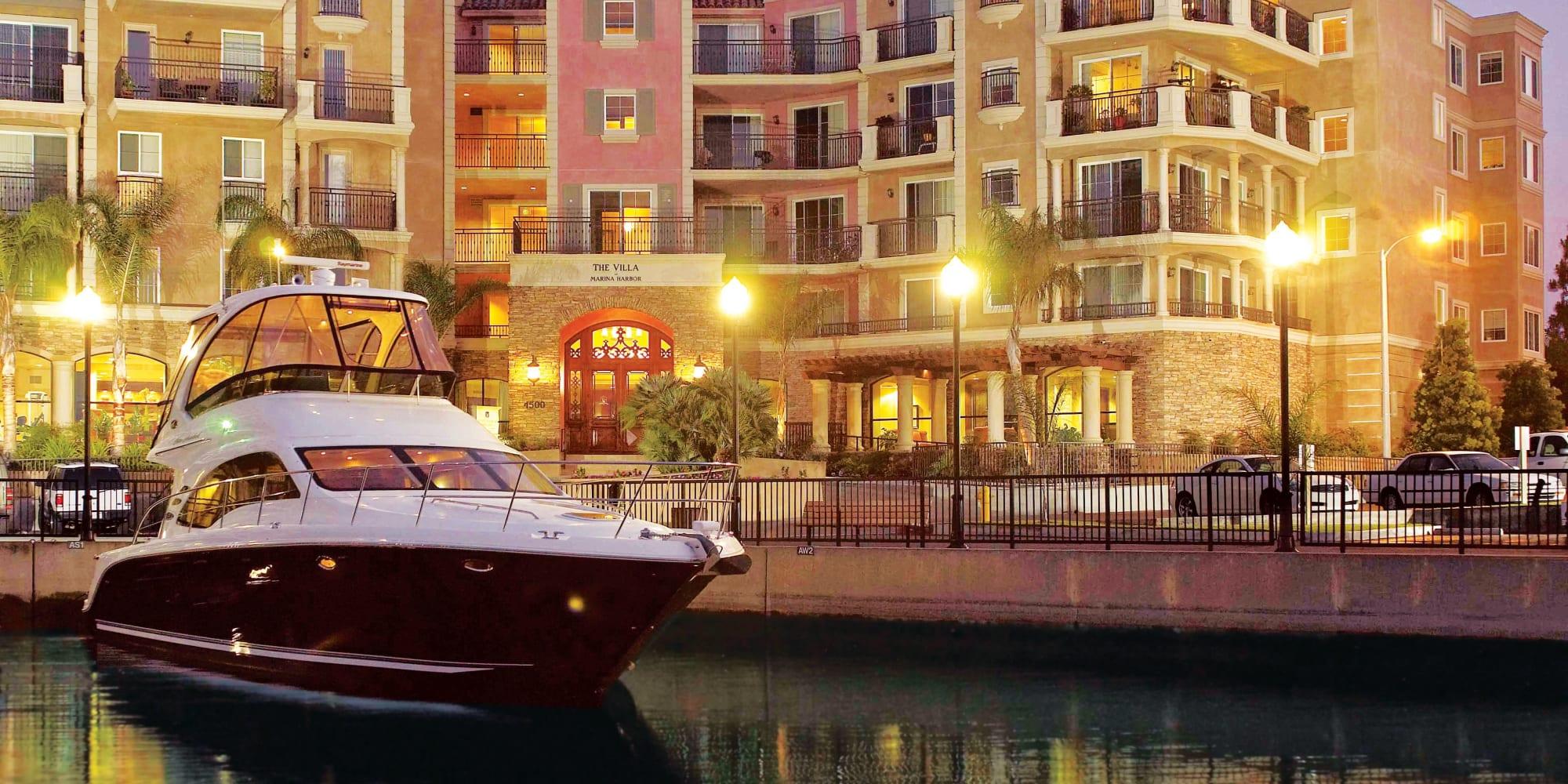 Boat docked in the evening outside at The Villa at Marina Harbor in Marina del Rey, California
