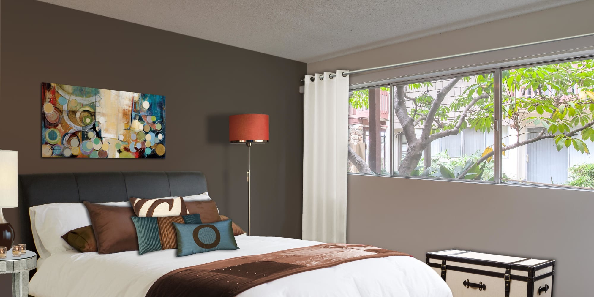 Accent wall and modern furnishings in a model apartment's bedroom at Rancho Los Feliz in Los Angeles, California
