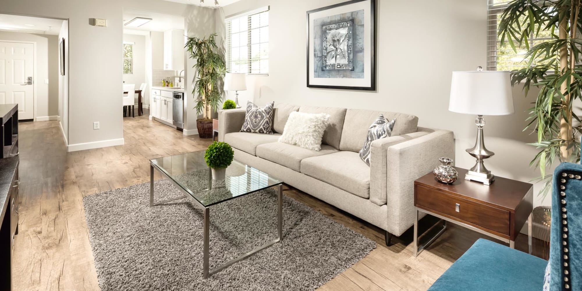Hardwood flooring in the well-furnished living area of a model home at Mission Hills in Camarillo, California