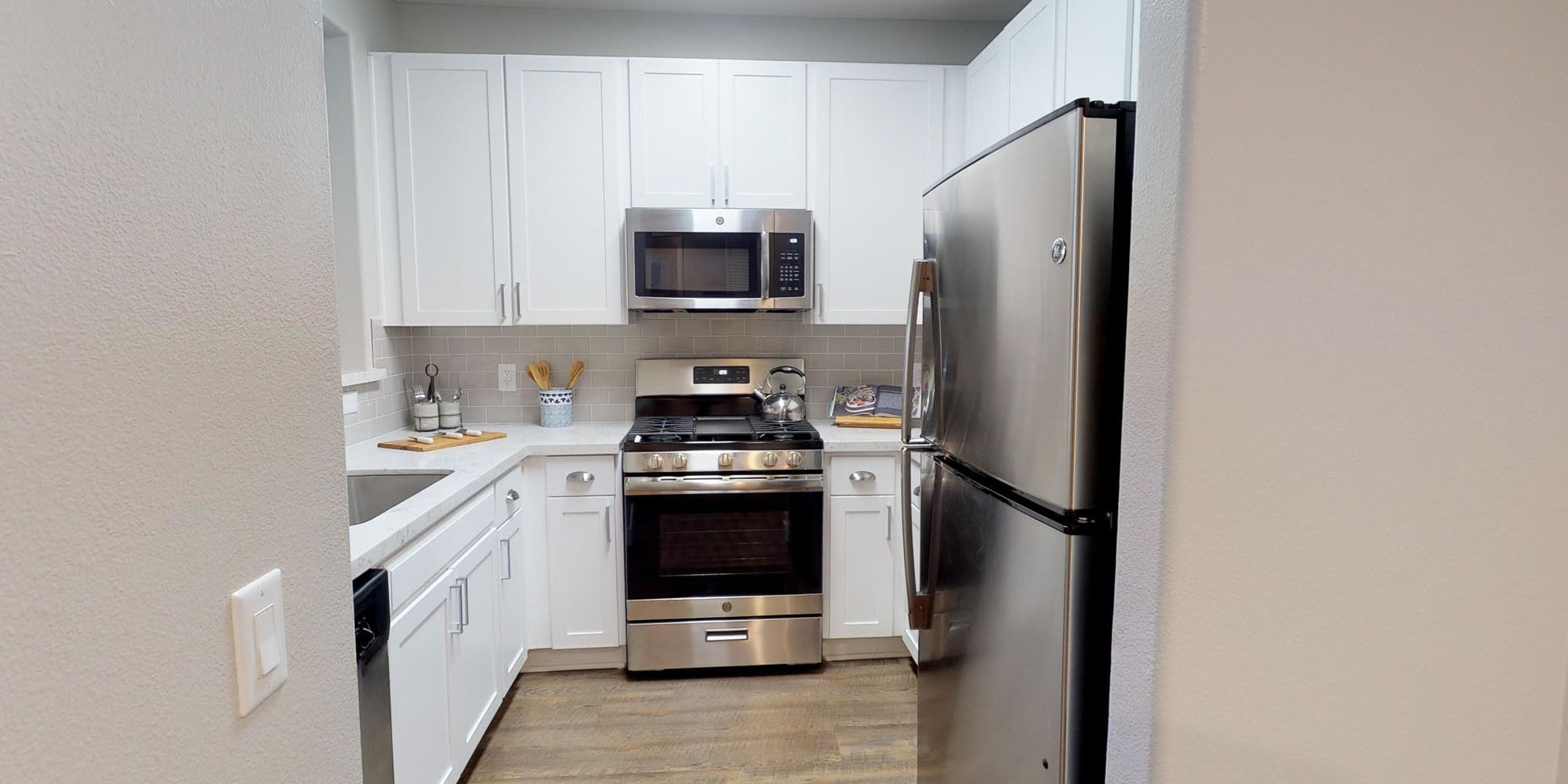 Stainless-steel appliances in a model home's kitchen at Mission Hills in Camarillo, California
