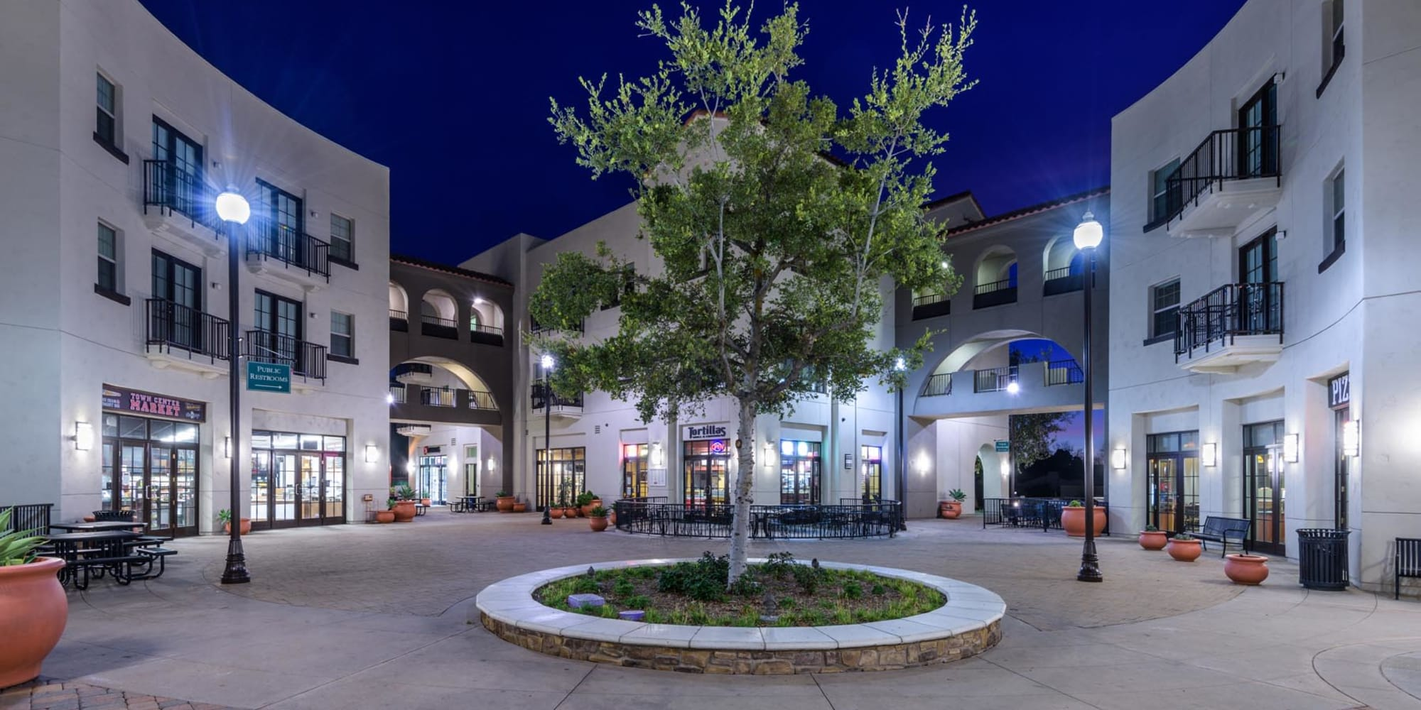 Well-lit retail courtyard in the evening at Mission Hills in Camarillo, California
