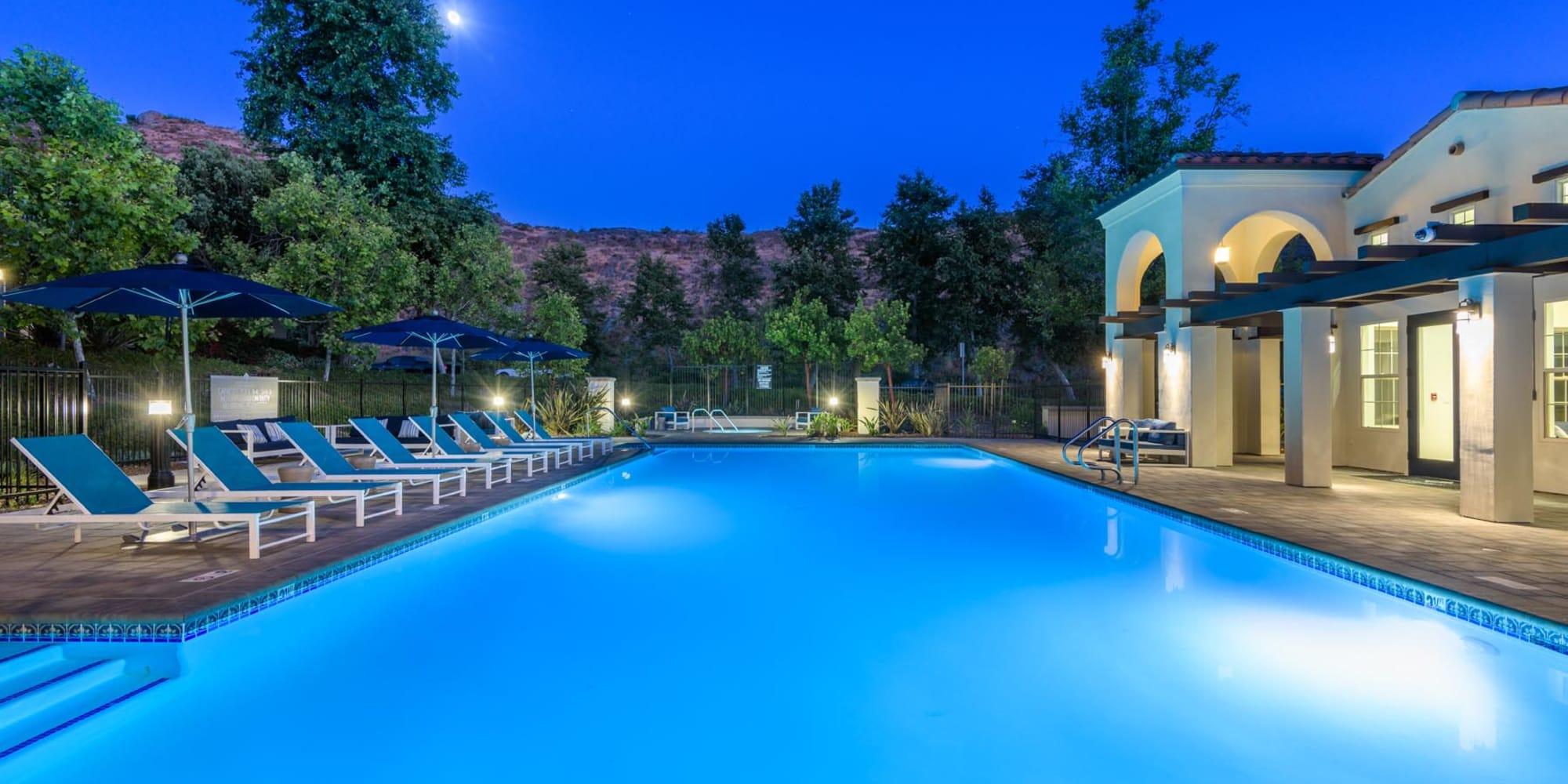 Underwater lights illuminating the pool at dusk at Mission Hills in Camarillo, California
