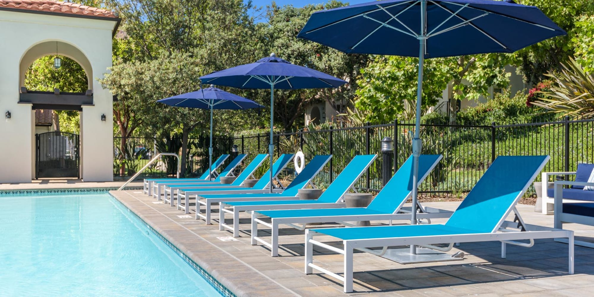 Chaise lounge chairs around the swimming pool at Mission Hills in Camarillo, California